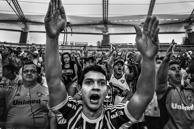 Fans during a soccer game between the Fluminense FC and Clube de Regatas do Flamengo.