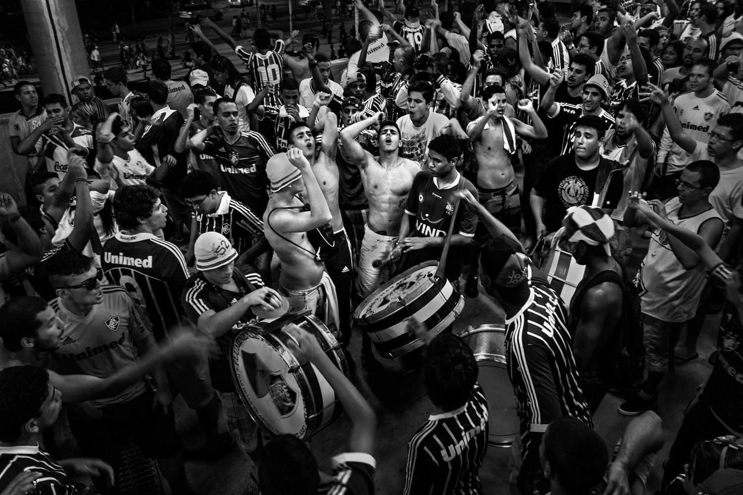 Fans of Fluminense FC at Maracana Stadium celebrating after a team win against Clube de Regatas do Flamengo. The teams are two of the most important in Rio de Janeiro.