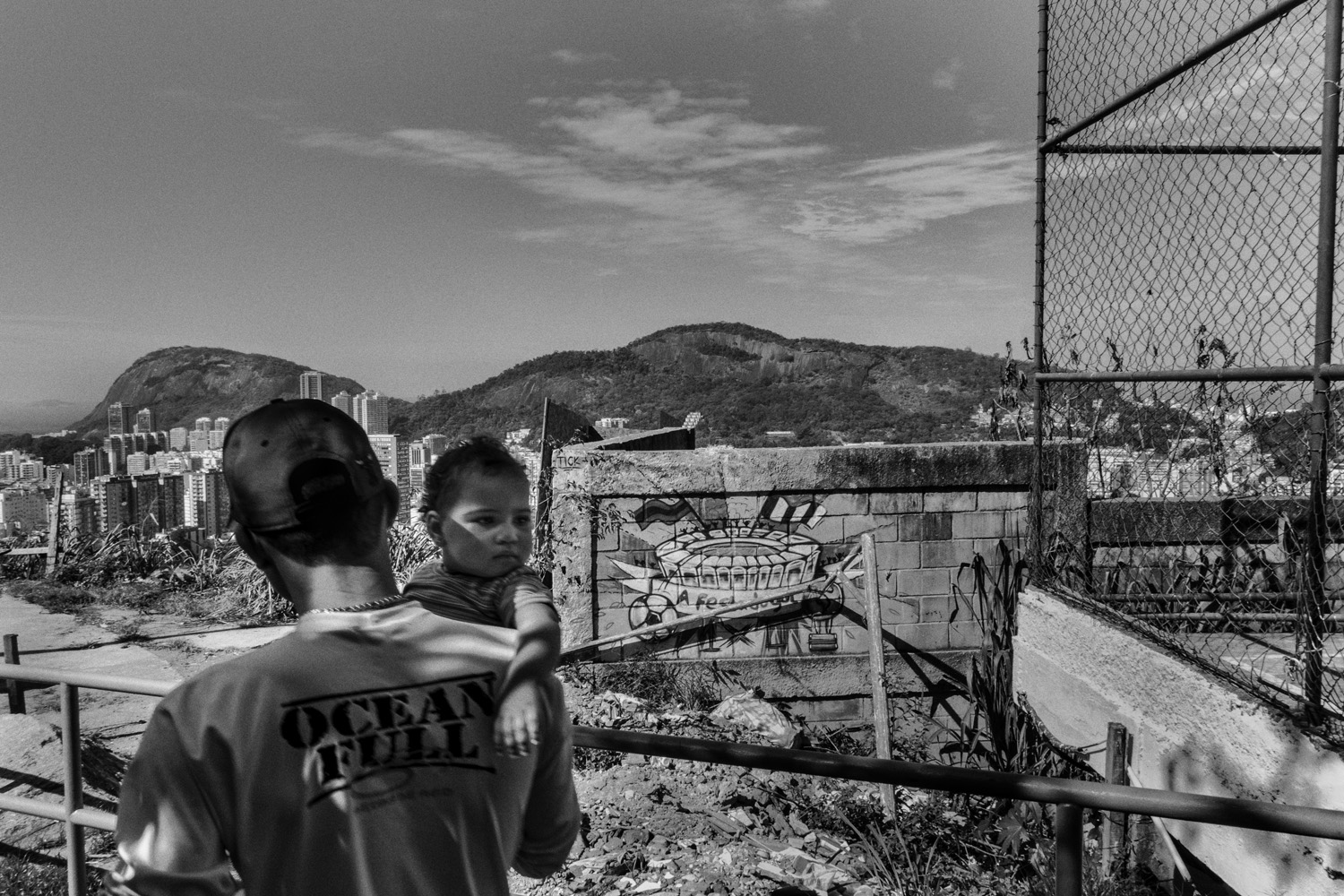 A father and his daughter are seen after a soccer game in the favela of Santa Marta near Rio de Janeiro's downtown.