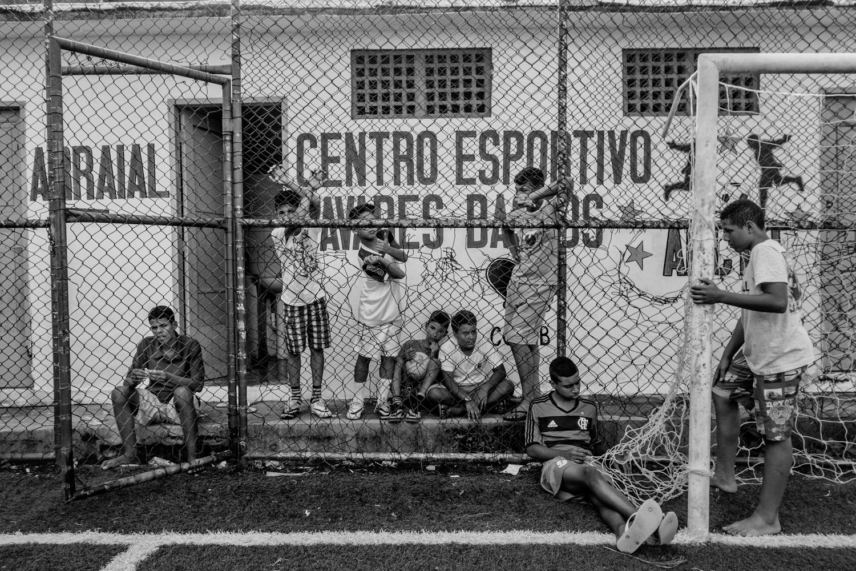 Children resting after soccer training in the soccer school for favela kids in Tavares Bastos favela near Rio de Janeiro's downtown.