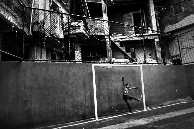 A young goalkeeper training in the soccer school for favela kids in Tavares Bastos favela near Rio de Janeiro's downtown.