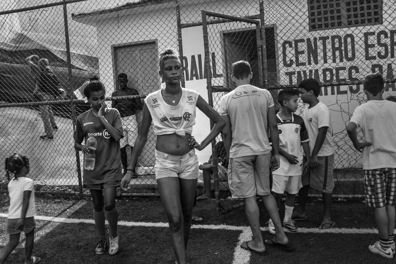 Children resting after soccer training in Tavares Bastos favela near Rio de Janeiro's downtown.