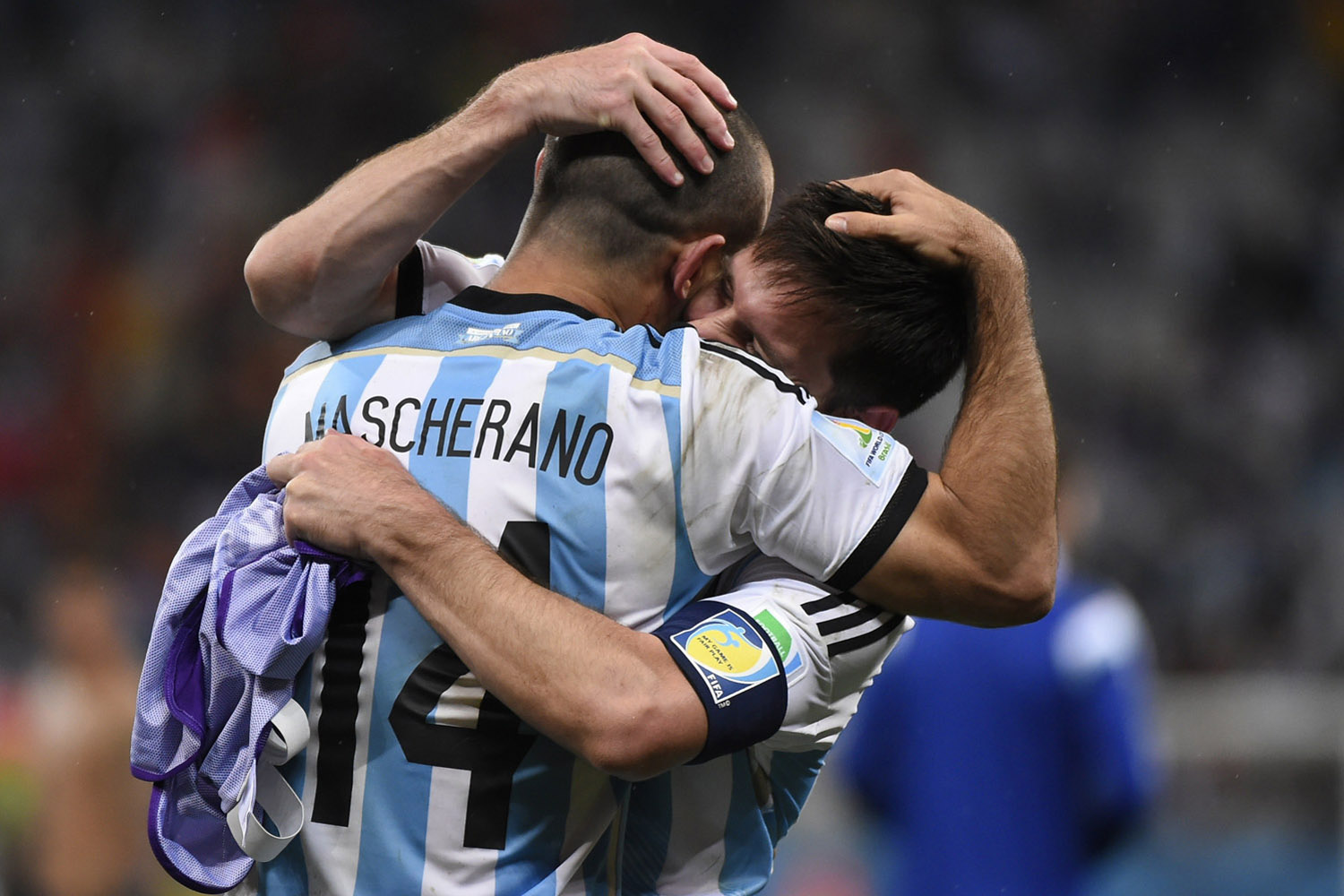 Argentina's midfielder Javier Mascherano (front) and Argentina's forward and captain Lionel Messi  celebrate after winning their FIFA World Cup semi-final match against the Netherlands in a penalty shoot-out following extra time at The Corinthians Arena in Sao Paulo on July 9, 2014.