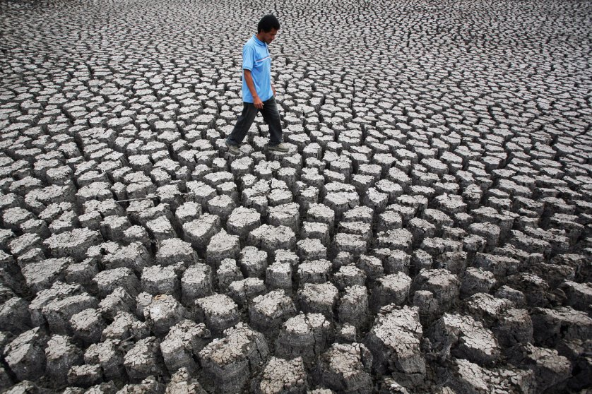 Fruto Garcia walks on the ground cracked by drought in the Las Canoas Lake, Nicaragua on April 8, 2010. The lack of rain caused by the El Nino meteorological phenomena decreased water level in Las Canoas Lake, located in the center of Nicaragua, affecting approximately eight thousand people who live in the surrounding areas.