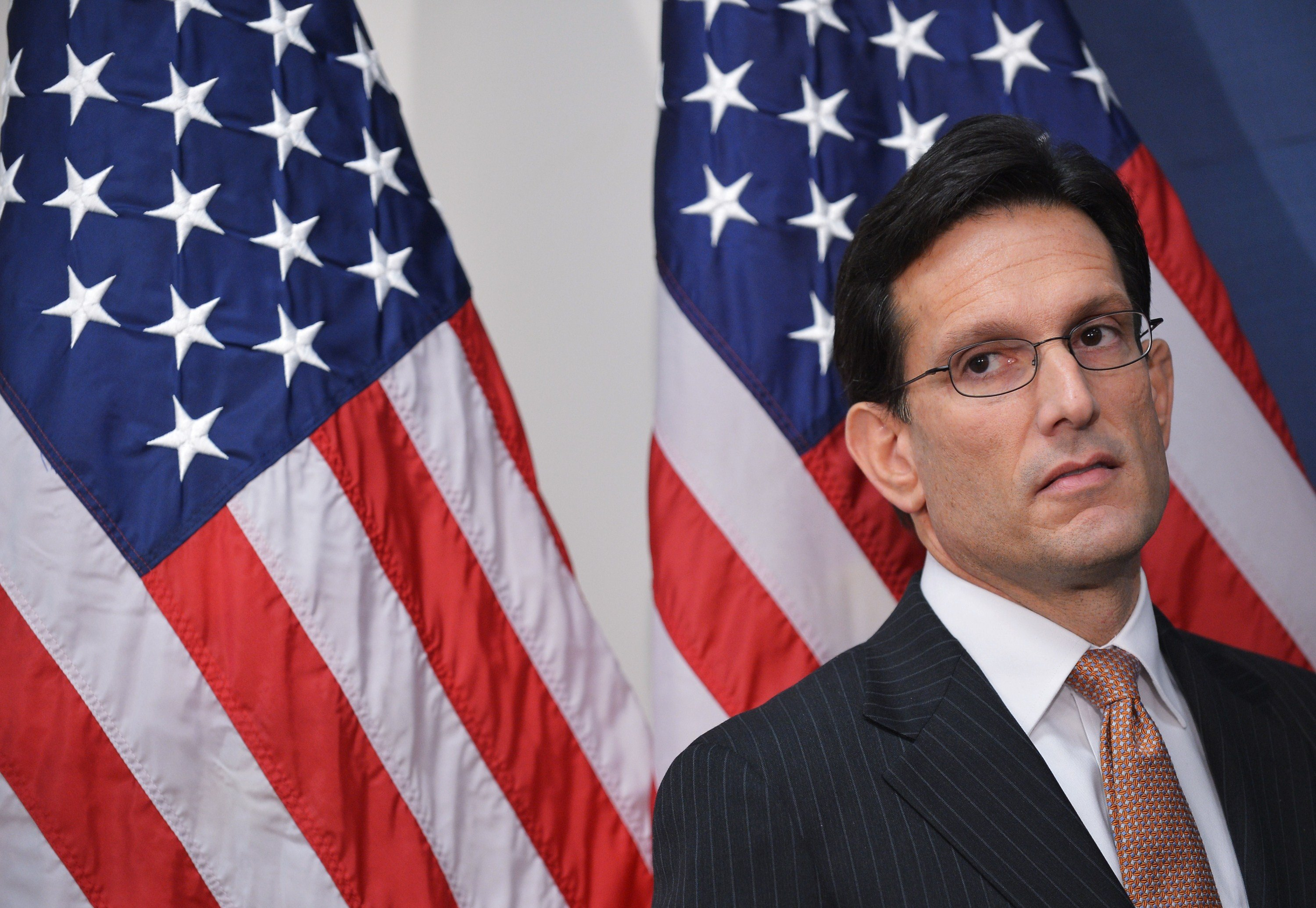 Eric Cantor listening to a speaker during a press conference following a Republican Conference meeting at the US Capitol in Washington.