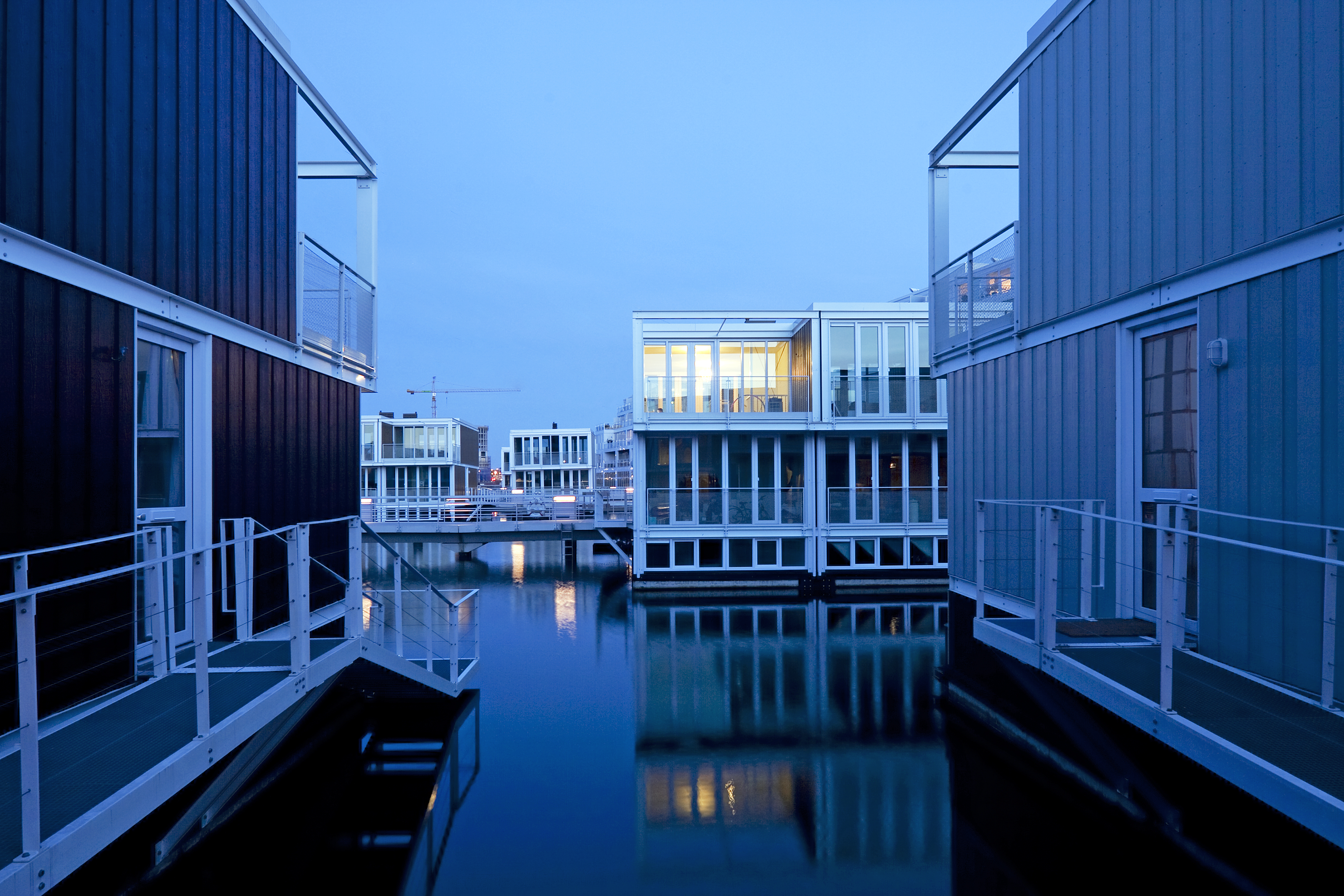 Fifty-five homes float in the IJburg district in east Amsterdam. The structures, designed by  the Dutch firm Marlies Rohmer Architects, sit on hollow concrete  tubs  that are submerged half a story.