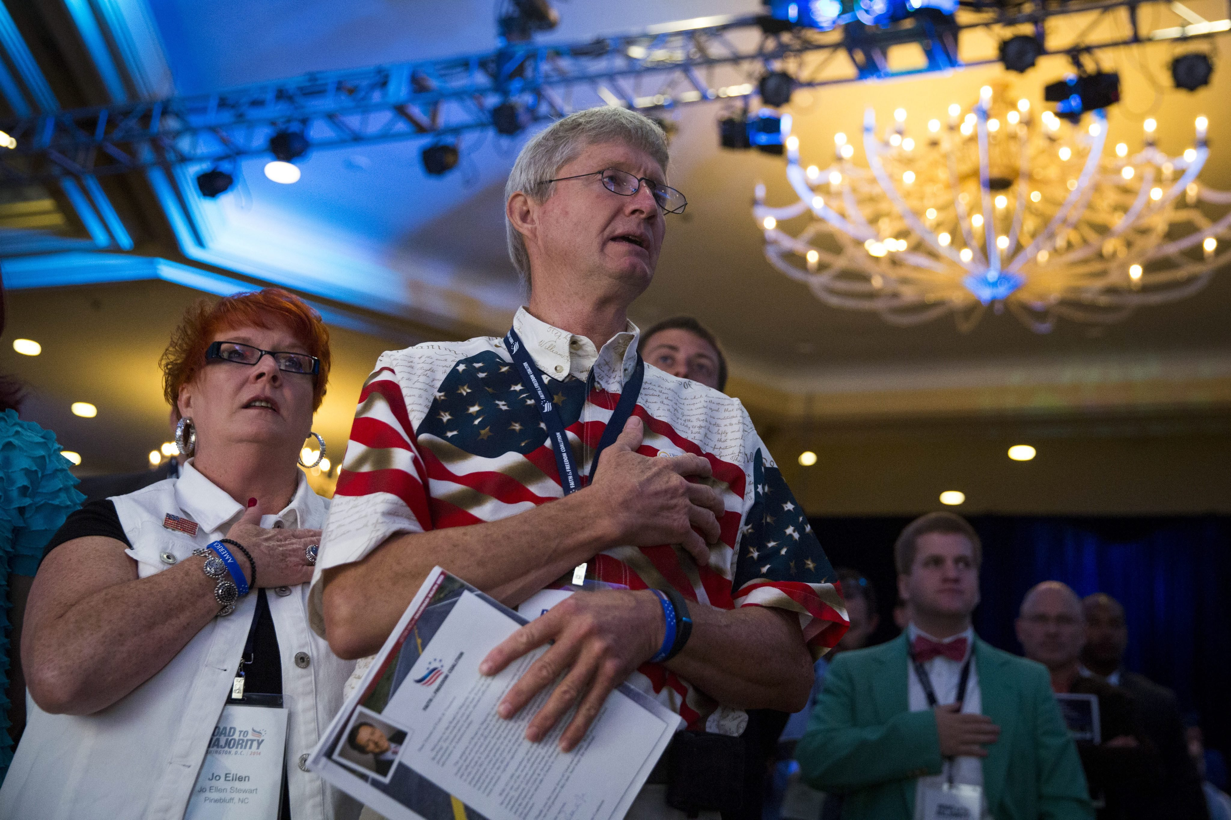 Attendees recite the Pledge of Allegiance during the Faith and Freedom Coalition's  Road to Majority  conference in Washington, June 20, 2014.