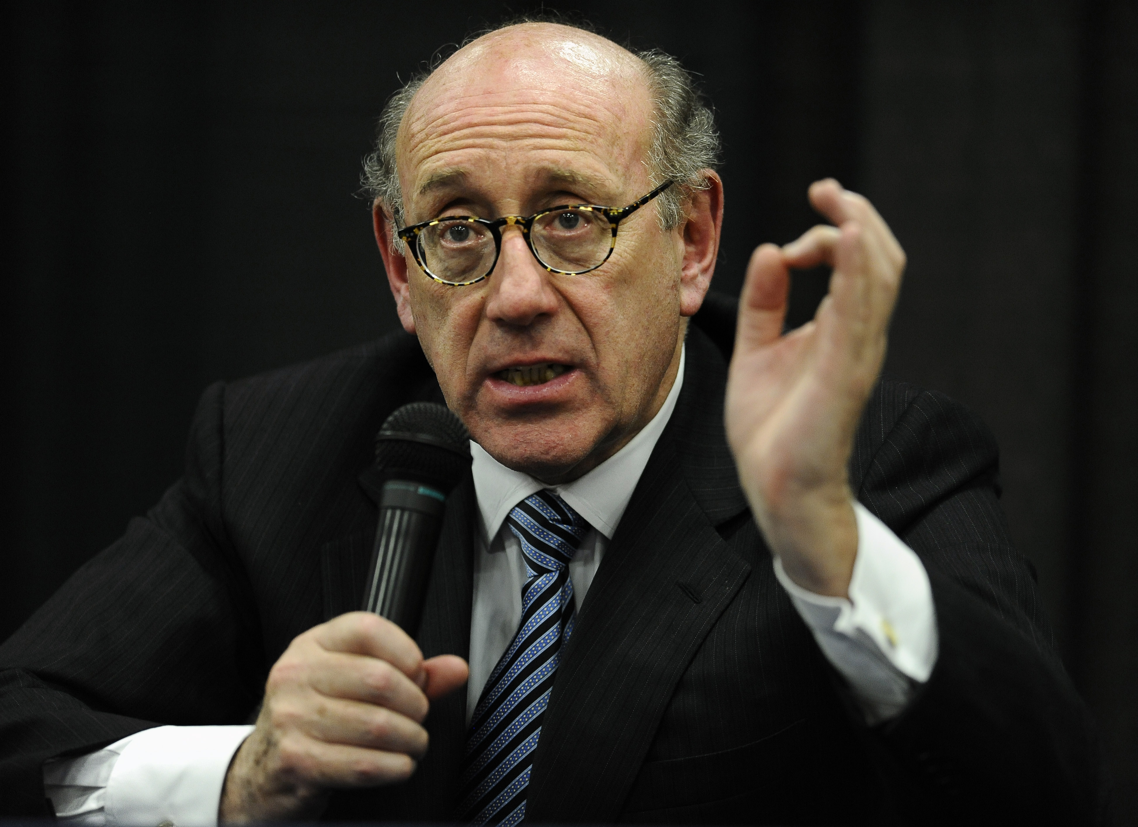 Attorney and special adviser Kenneth Feinberg speaks at a public forum on the distribution of Newtown donations at Edmond Town Hall in Newtown, Conn. on July 11, 2013.