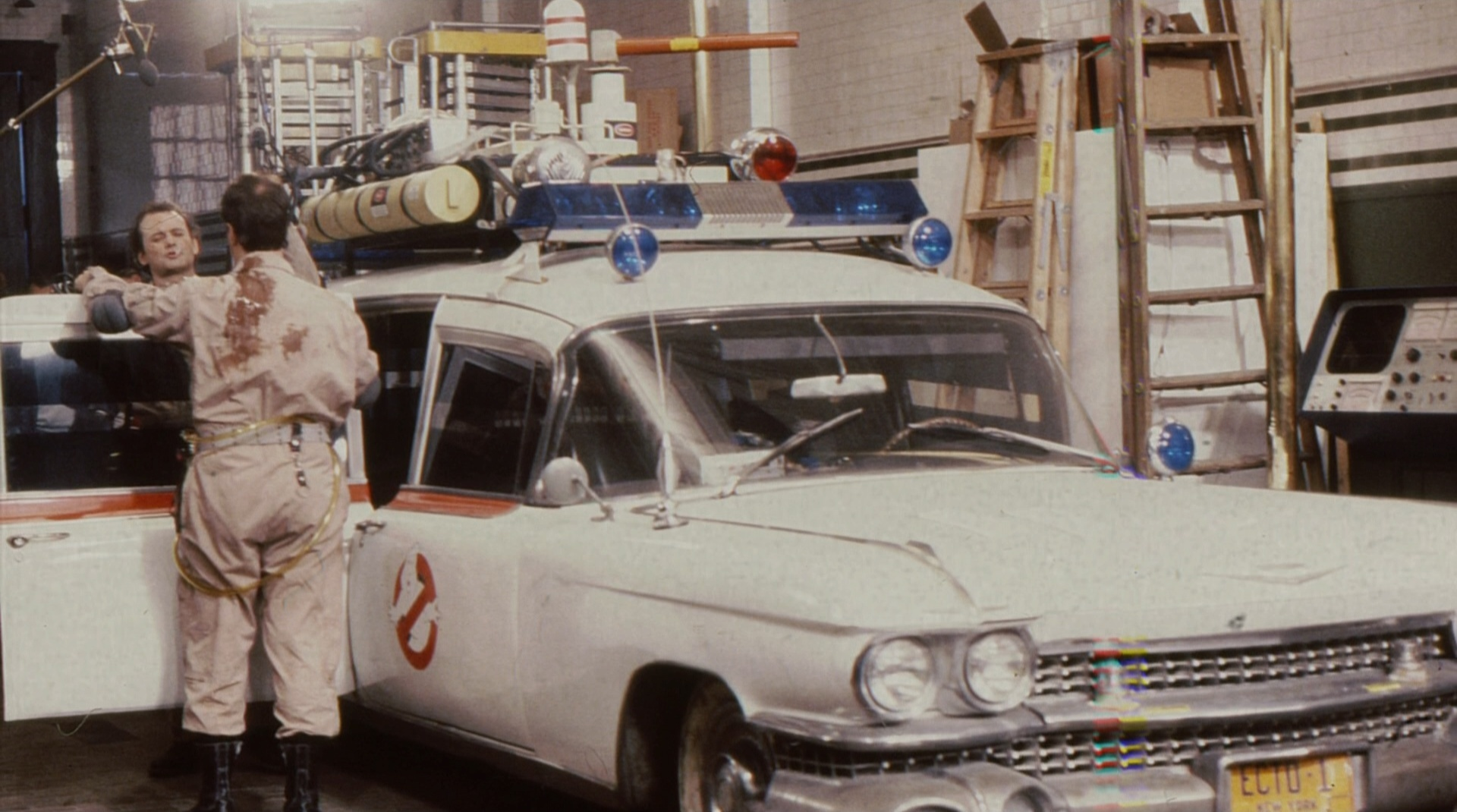 Bill Murray and Dan Aykroyd act out a scene next to Ecto-1, the Ghostbusters' vehicle of choice.