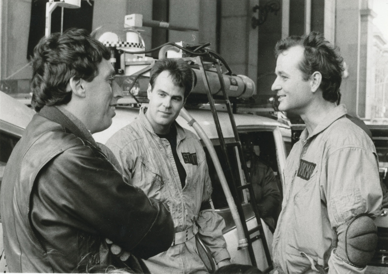 Producer/director Ivan Reitman talks with Dan Aykroyd and Bill Murray on set.
