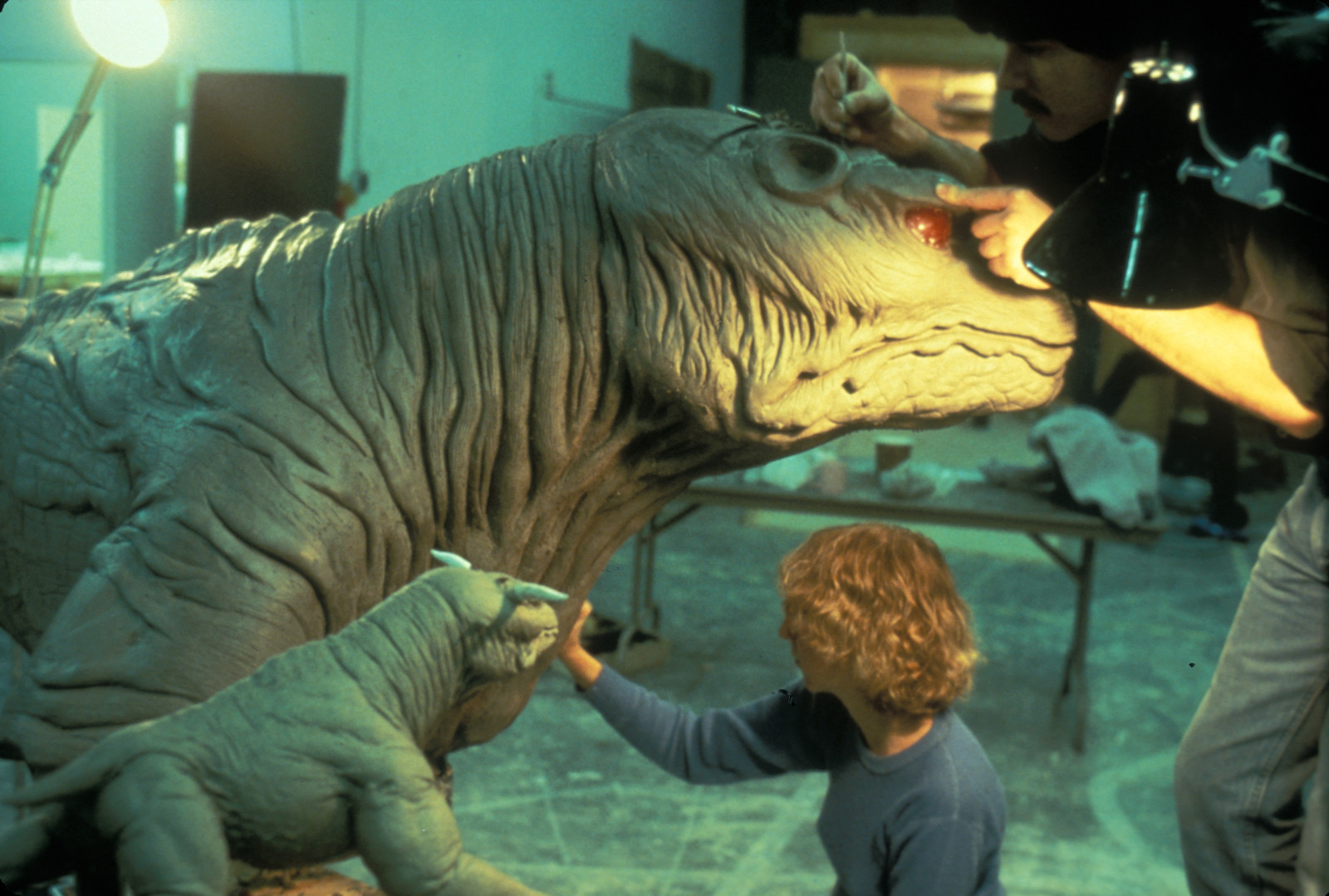 The special effects team sculpts clay models of monsters.