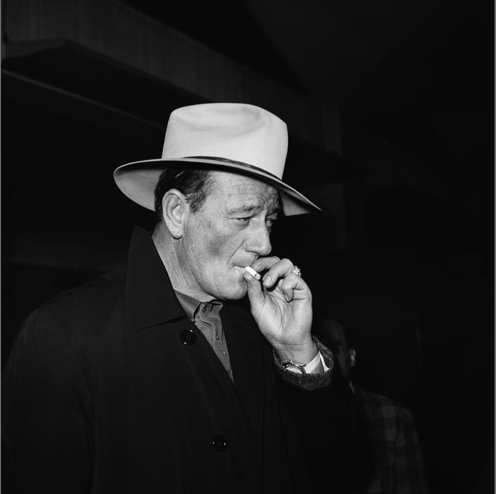 Actor John Wayne arrives at Ciampino Airport in Rome in 1960.
