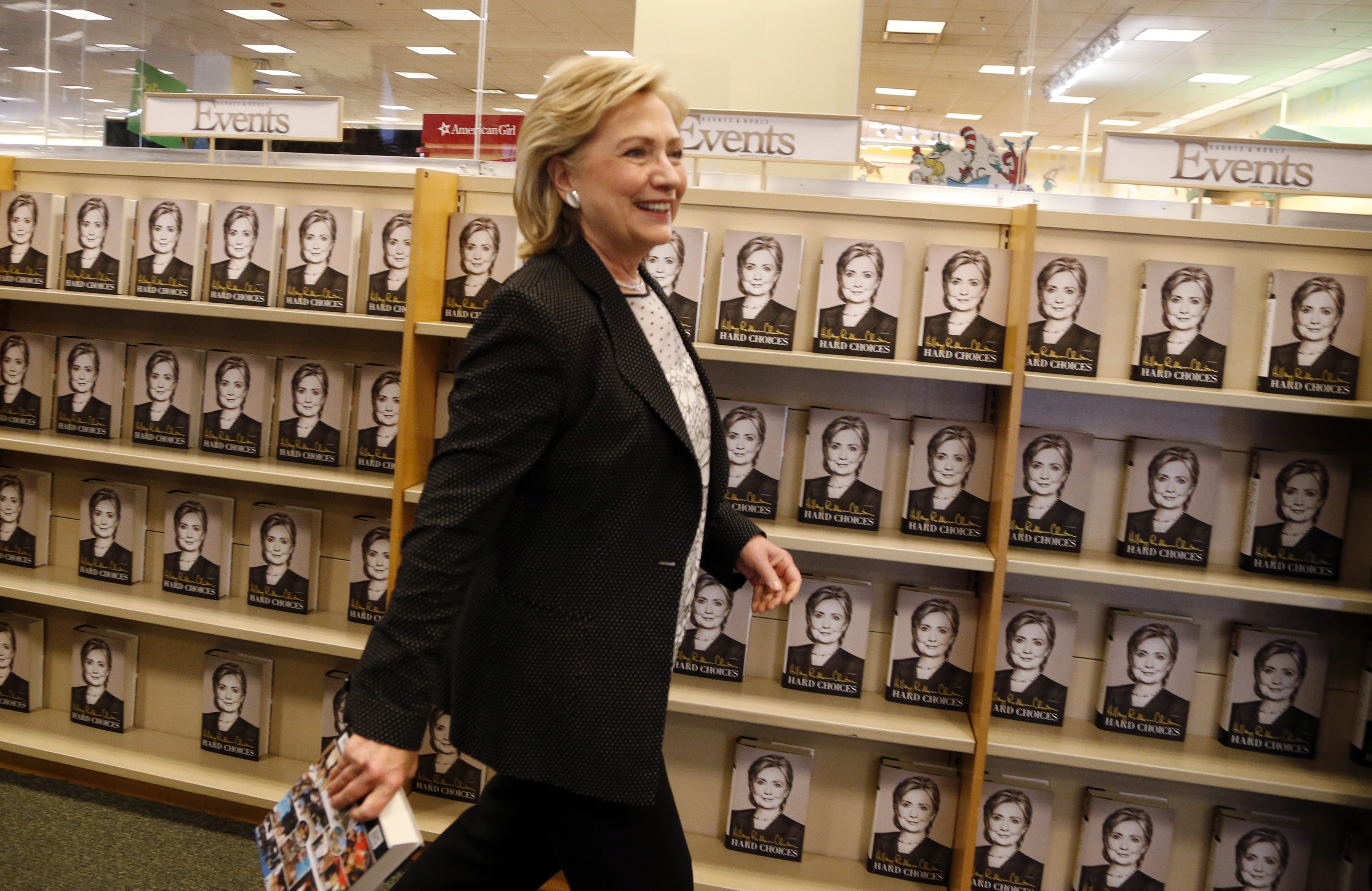 Former U.S. Secretary of State Hillary Clinton arrives to sign copies of her book  Hard Choices  at a Barnes & Noble book store in Los Angeles, California on June 19, 2014.