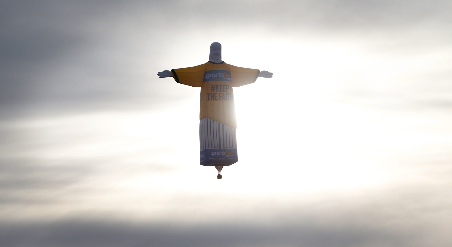 A giant hot air balloon in the shape of Brazils Christ The Redeemer statue wears an Australian football jersey flying over the Sydney skyline in support of the Australian team ahead of the 2014 World Cup in Brazil.