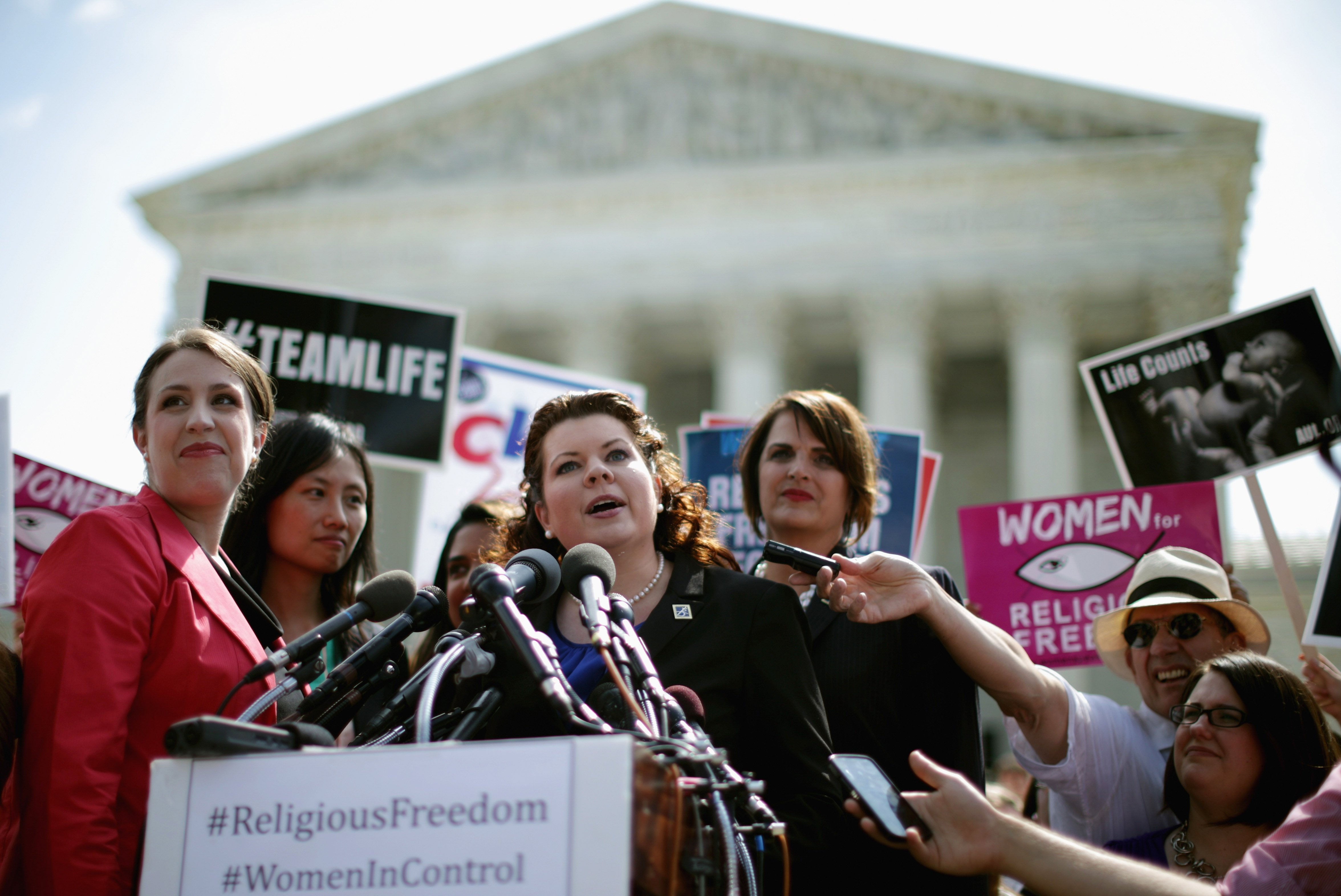 Lori Windham (C), senior counsel for The Becket Fund for Religious Liberty, addresses the news media in front of the Supreme Court after the decision in Burwell v. Hobby Lobby Stores June 30, 2014 in Washington.
