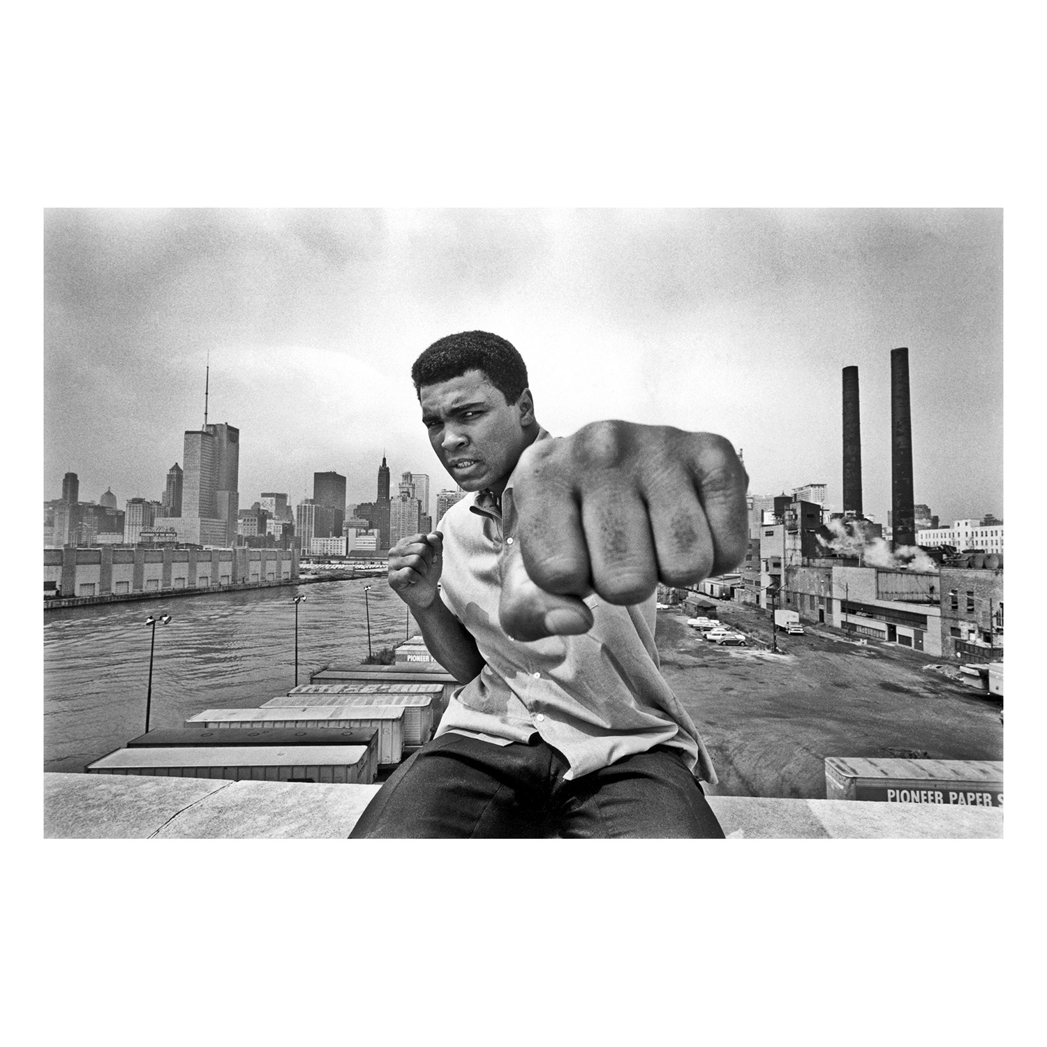 Muhammad ALI on a bridge overlooking the Chicago River and the city's skyline. Chicago, Illinois. USA. 1966.