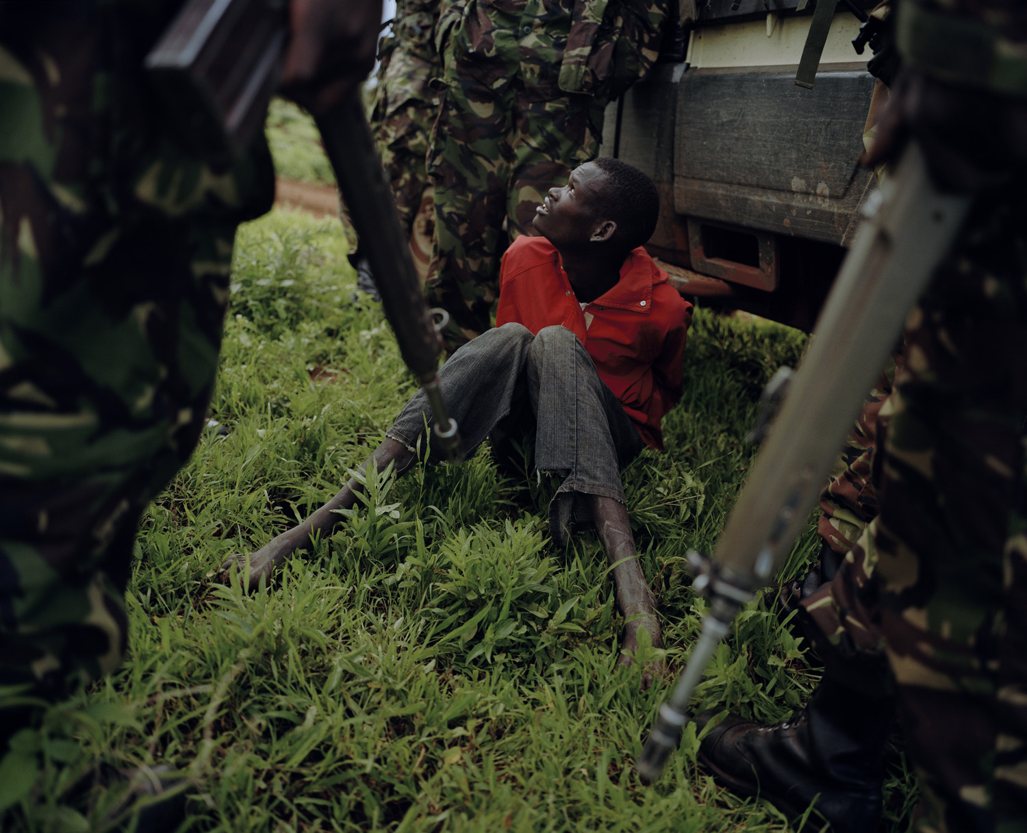 A poacher is interrogated by members of KWS and the community conservancy anti poaching unit '9.2'.                                                                      Part of a team intent on poaching, possibly the youngest and most inexperienced of the group, he was found by the teams blood hounds breathing through a reed, under the surface of a river. He will almost certainly spend a considerable amount of time in prison. The others escaped.