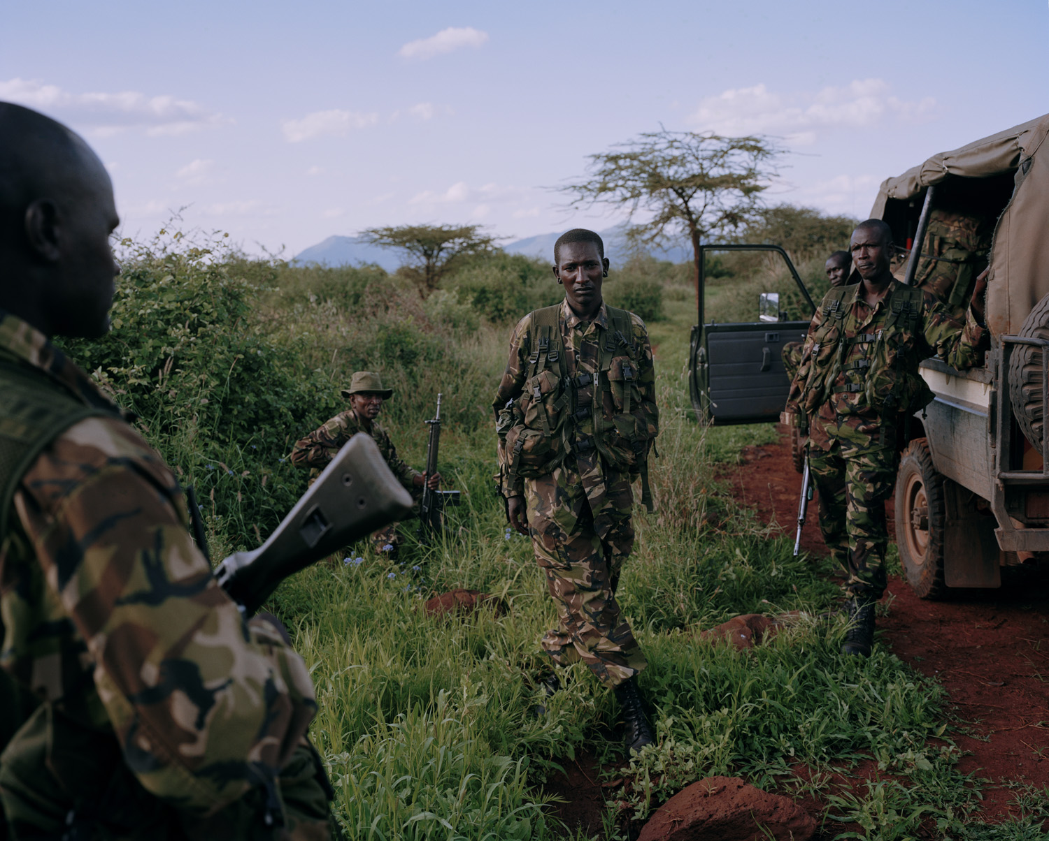 "Members of ""Call Sign 9.2"" community conservancy anti-poaching unit at the scene of a poaching, Kalama Community Conservancy, Northern Kenya."