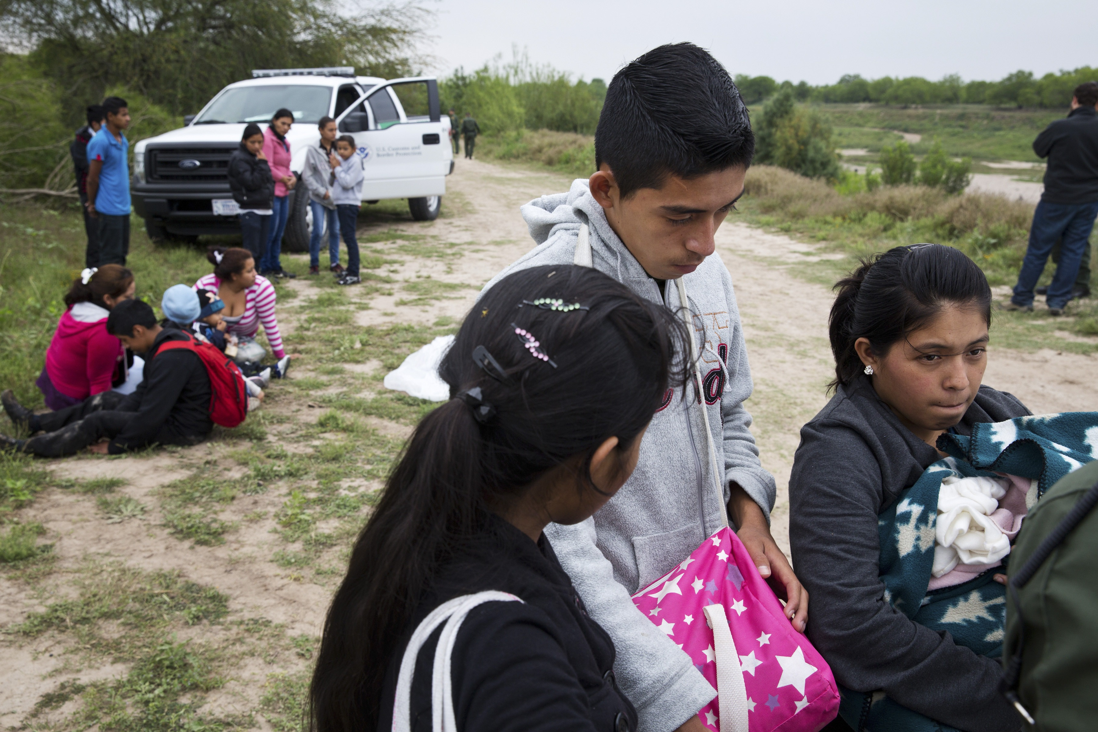 U.S. Border Patrol agents detain a group of young migrants from Honduras and Guatemala near the Anzalduas Dam at the Mexico-U.S. border in south Texas, March 25, 2014.