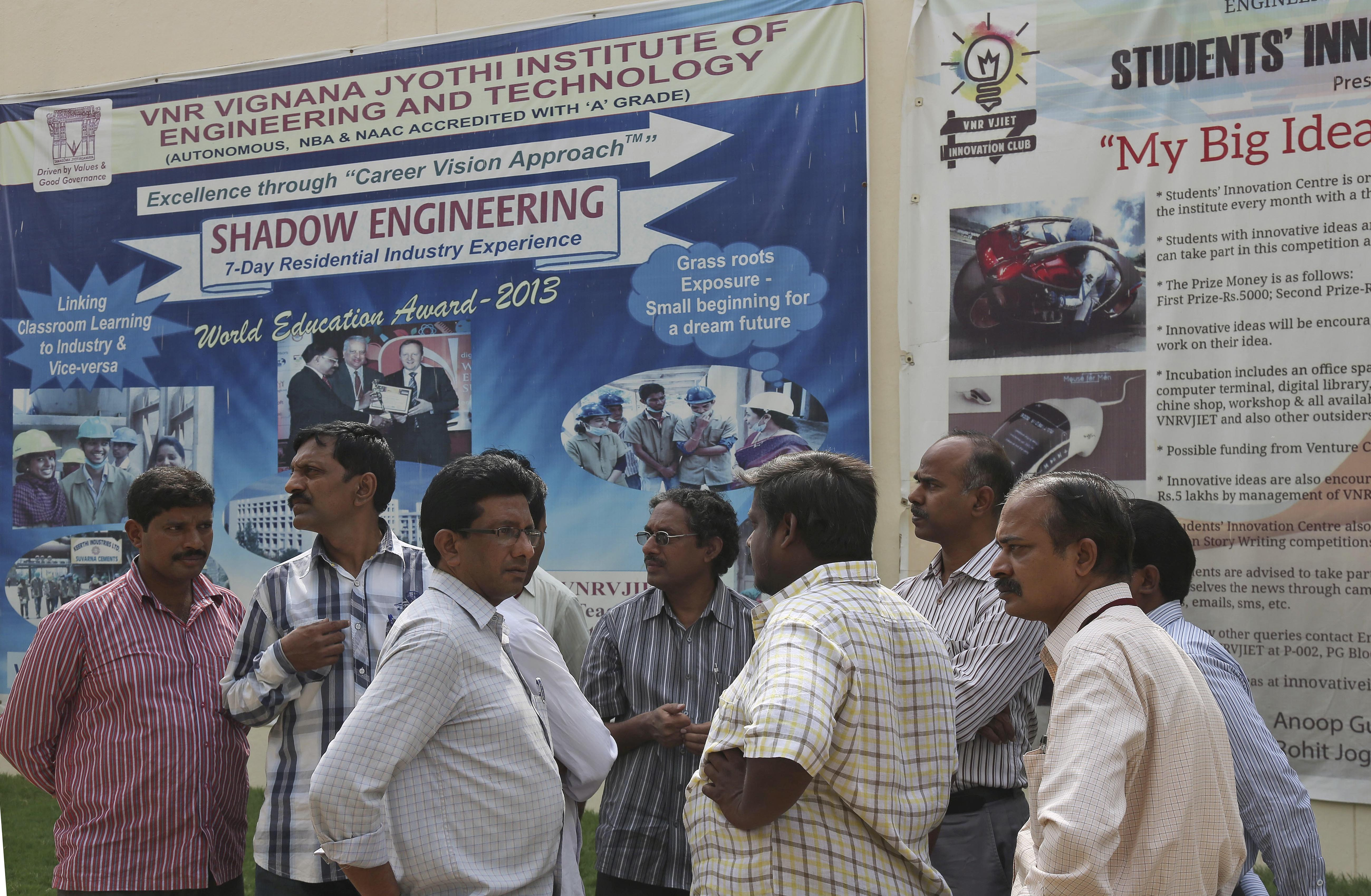 College staff working at VNR Vignana Jyothi Institute of Engineering and Technology gather on campus on the outskirts of Hyderabad, India, on June 9, 2014