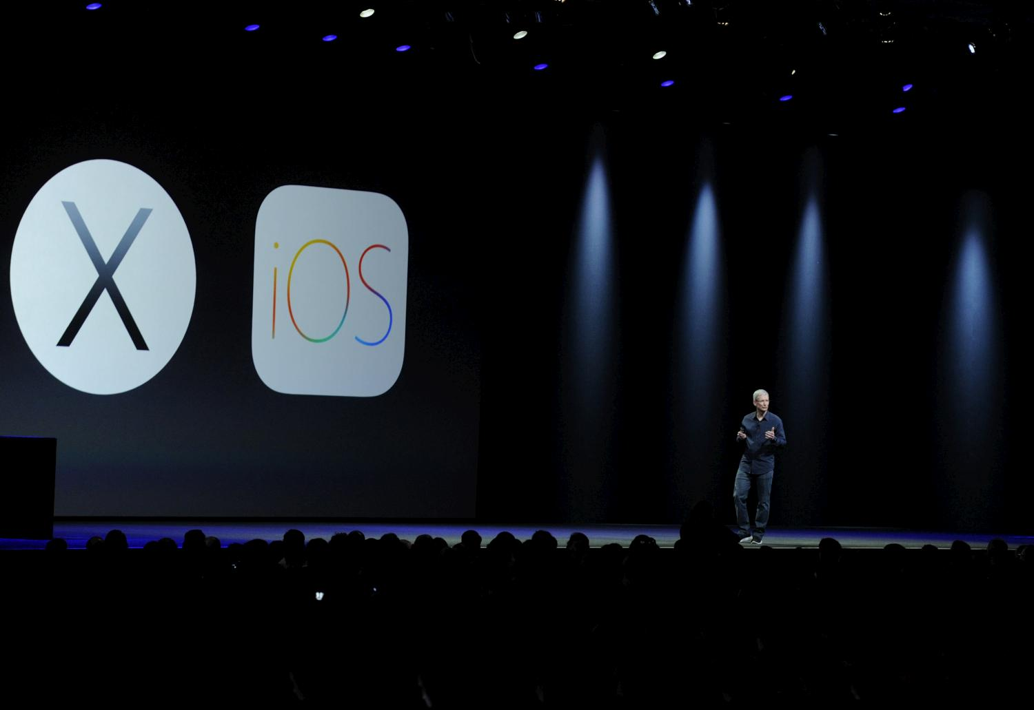 Apple CEO Tim Cook delivers the keynote address during the Apple World Wide Developers Conference (WWDC) in San Francisco on Monday, June 2, 2014.