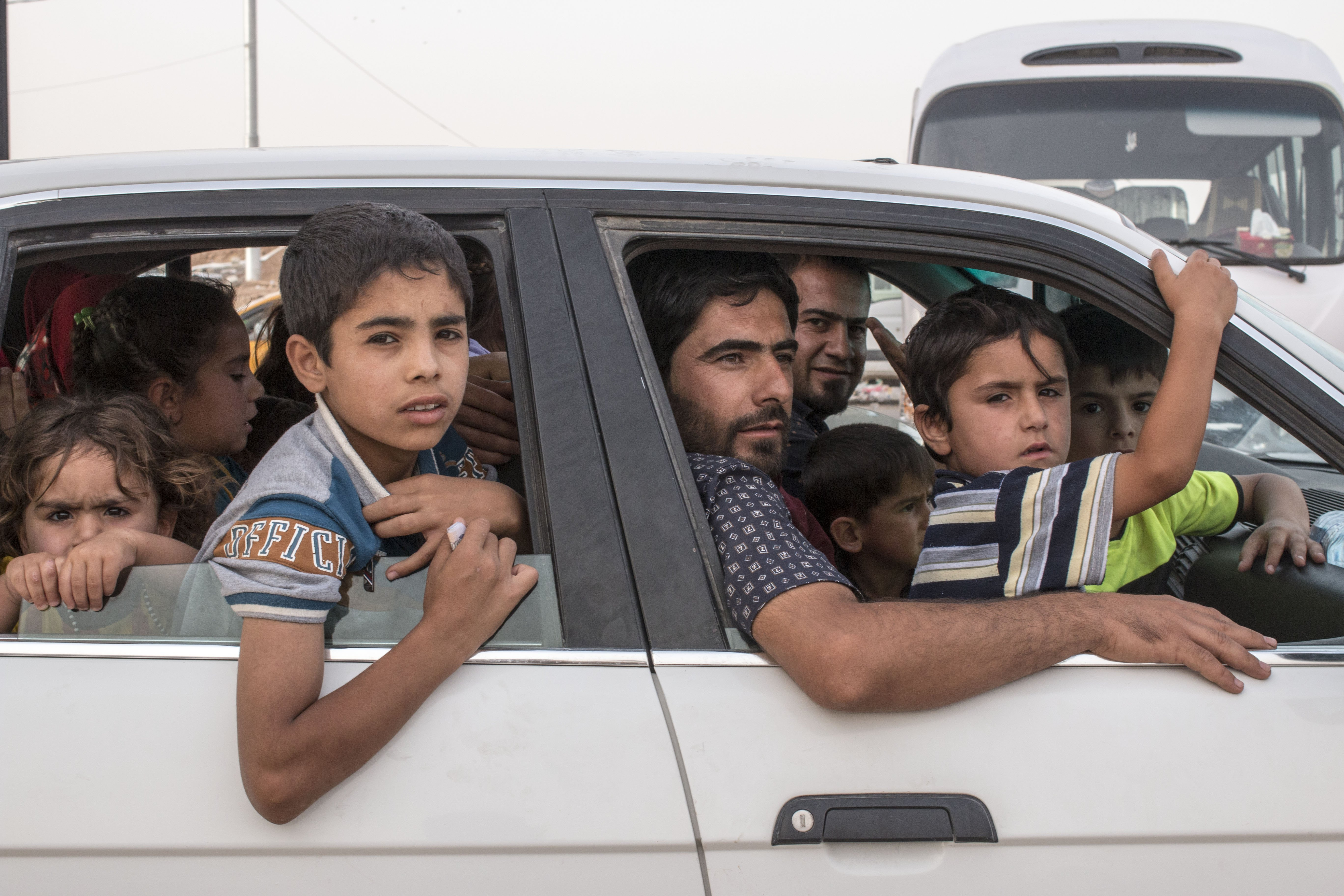 Children and families at a newly made refugee camp near Khazar check point in Mosul, Iraq on June 11, 2014.