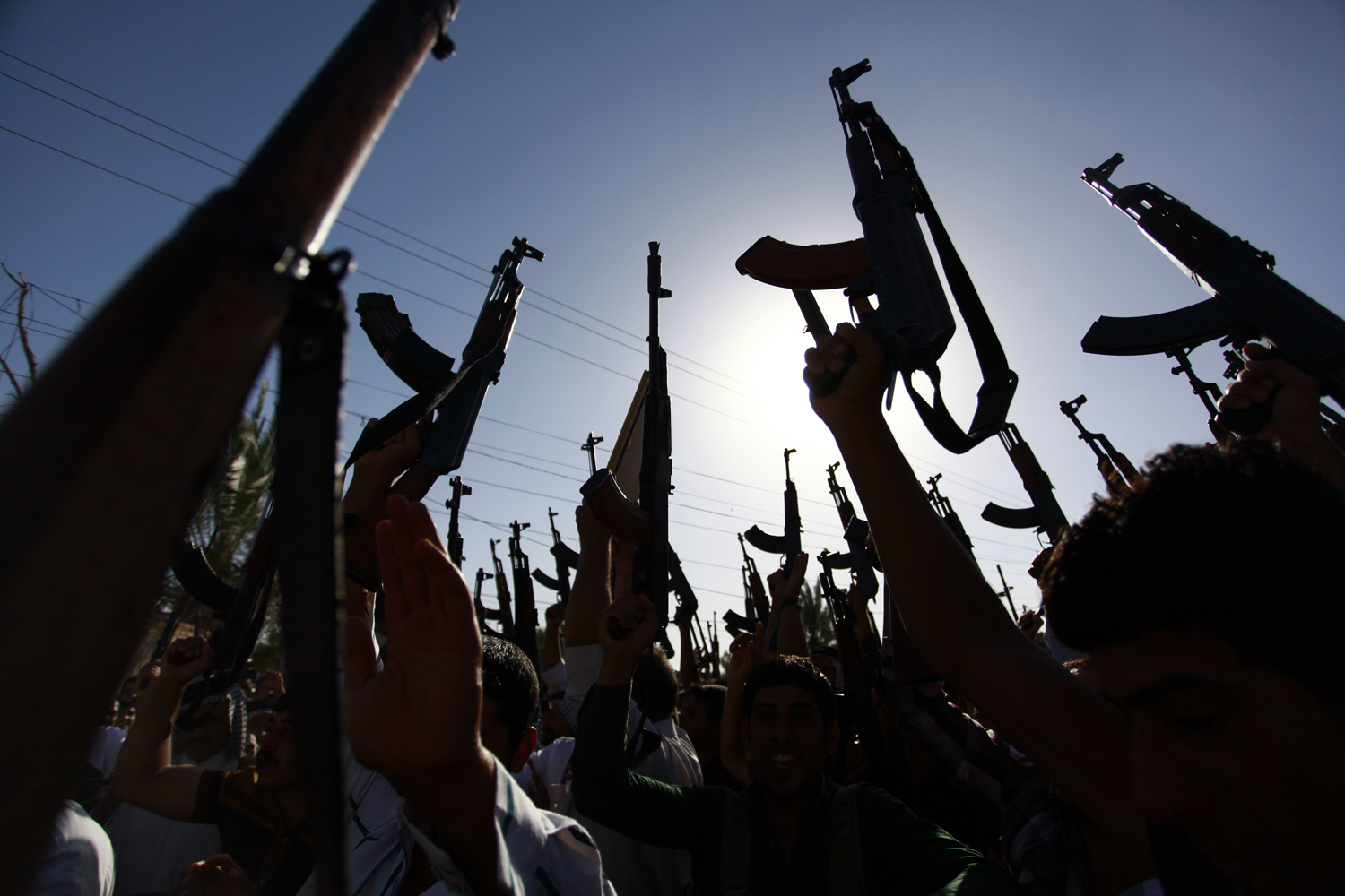 Iraqi Shiite tribesmen brandish their weapons as they gather to show their willingness to join Iraqi security forces in the fight against Jihadist militants who have taken over several northern Iraqi cities, on June 17 2014, in the southern Shiite Muslim shrine city of Najaf.