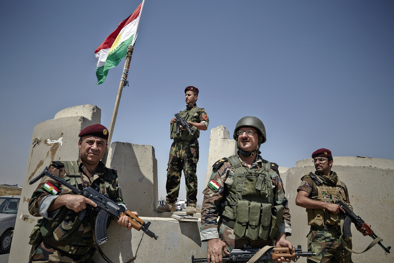 Kurdish Peshmerga fighters provide security at the last checkpoint outside of Mosul on June 14.