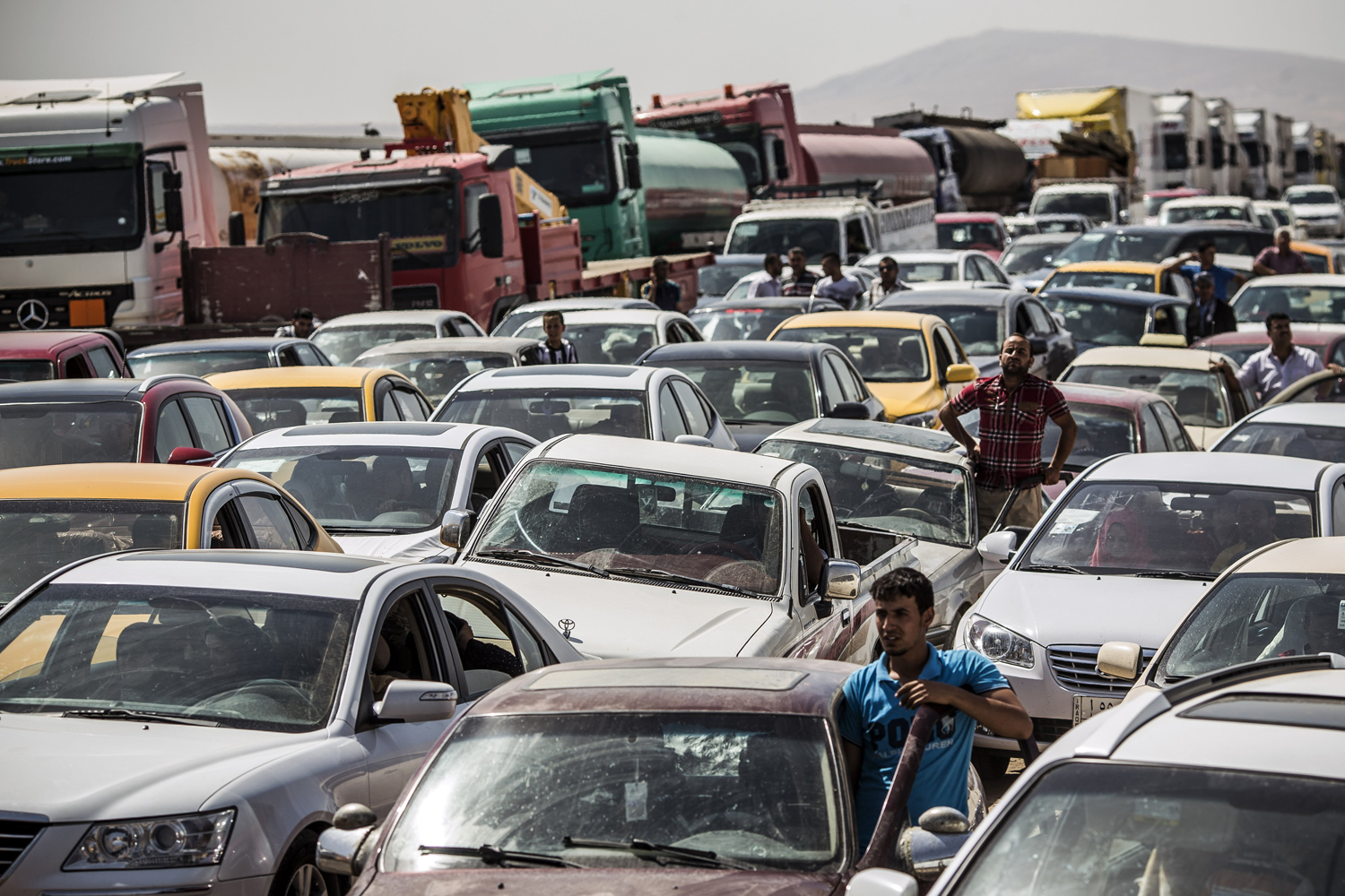 Traffic from Mosul queues at a Kurdish checkpoint on June 14,in Kalak.