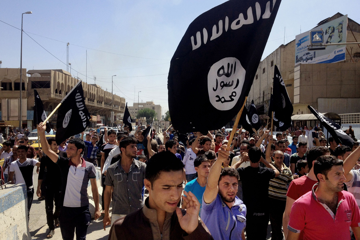 Demonstrators chant Islamic State of Iraq and Syria (ISIS) in front of the provincial government headquarters in Mosul, June 16, 2014.