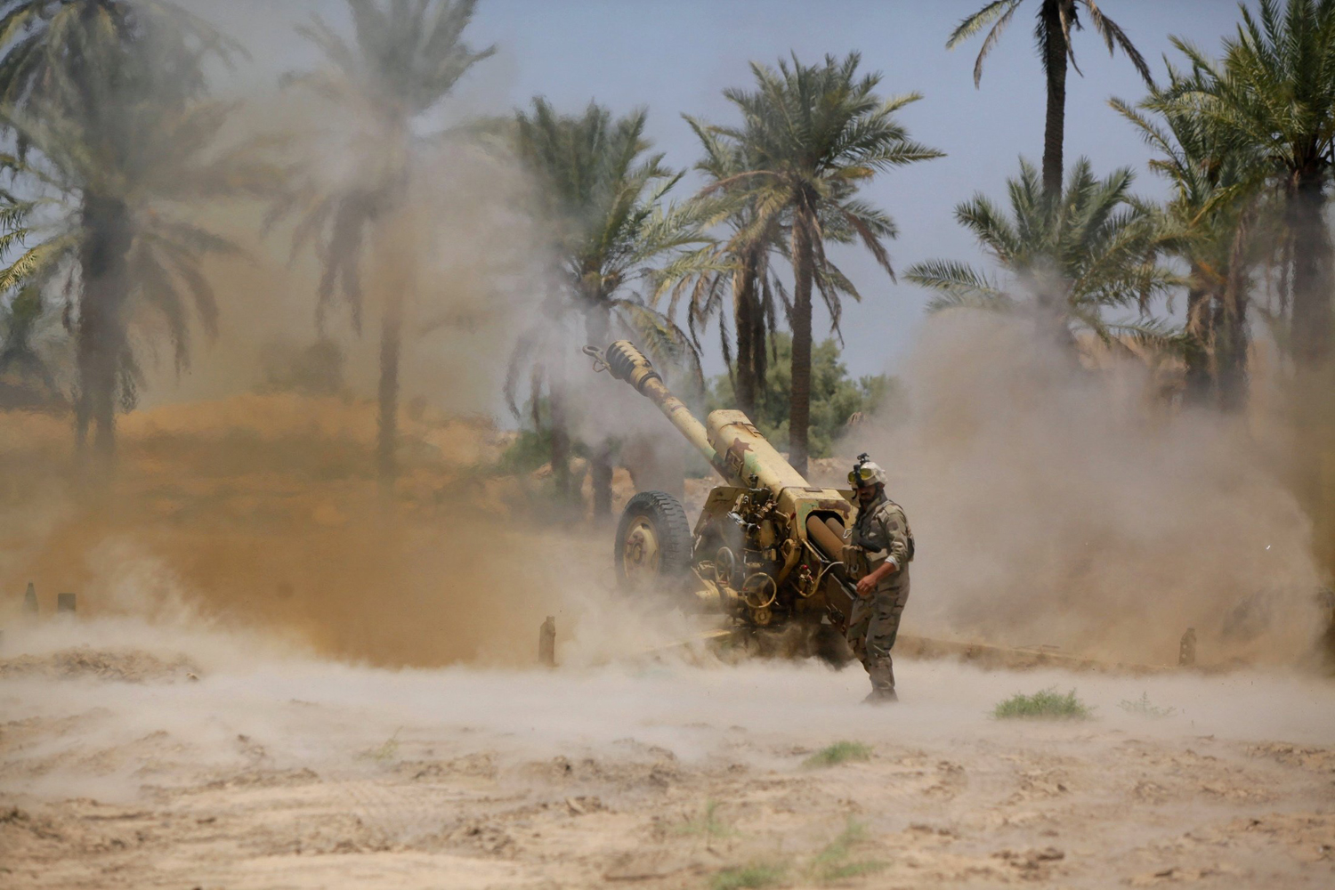 Iraqi security forces fire artillery during clashes with Sunni militant group Islamic State of Iraq and Syria (ISIS) in Jurf al-Sakhar June 14.