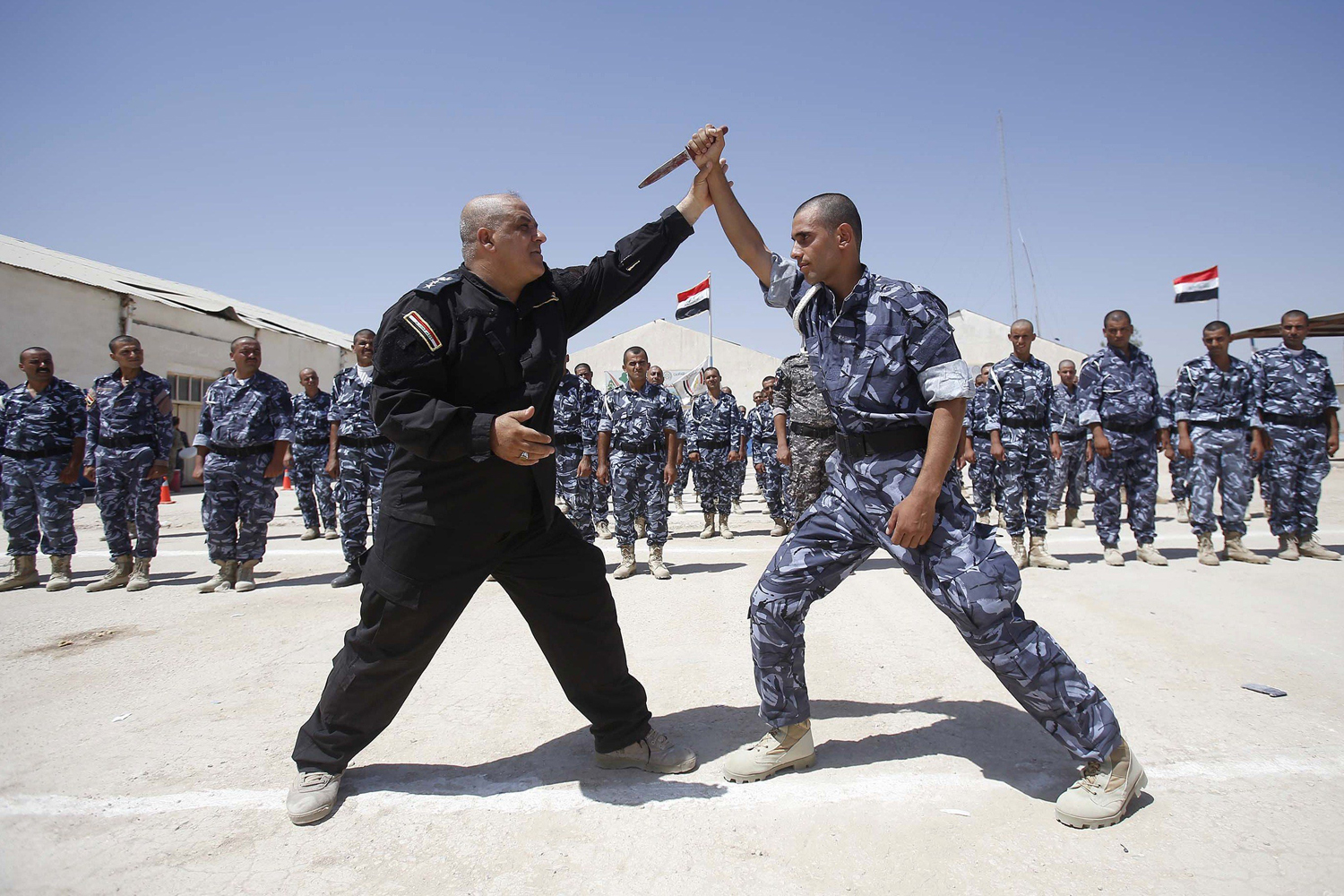 Newly-recruited Iraqi volunteers, wearing police forces uniforms, take part in a training session on June 17 in the central Shiite city of Karbala.