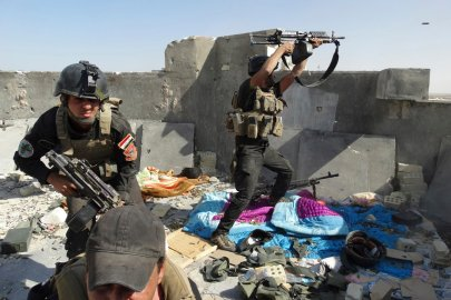 Members of the Iraqi Special Operations Forces take their positions during clashes with the al Qaeda-linked Islamic State of Iraq and the Syria (ISIS) in the city of Ramadi, June 19.