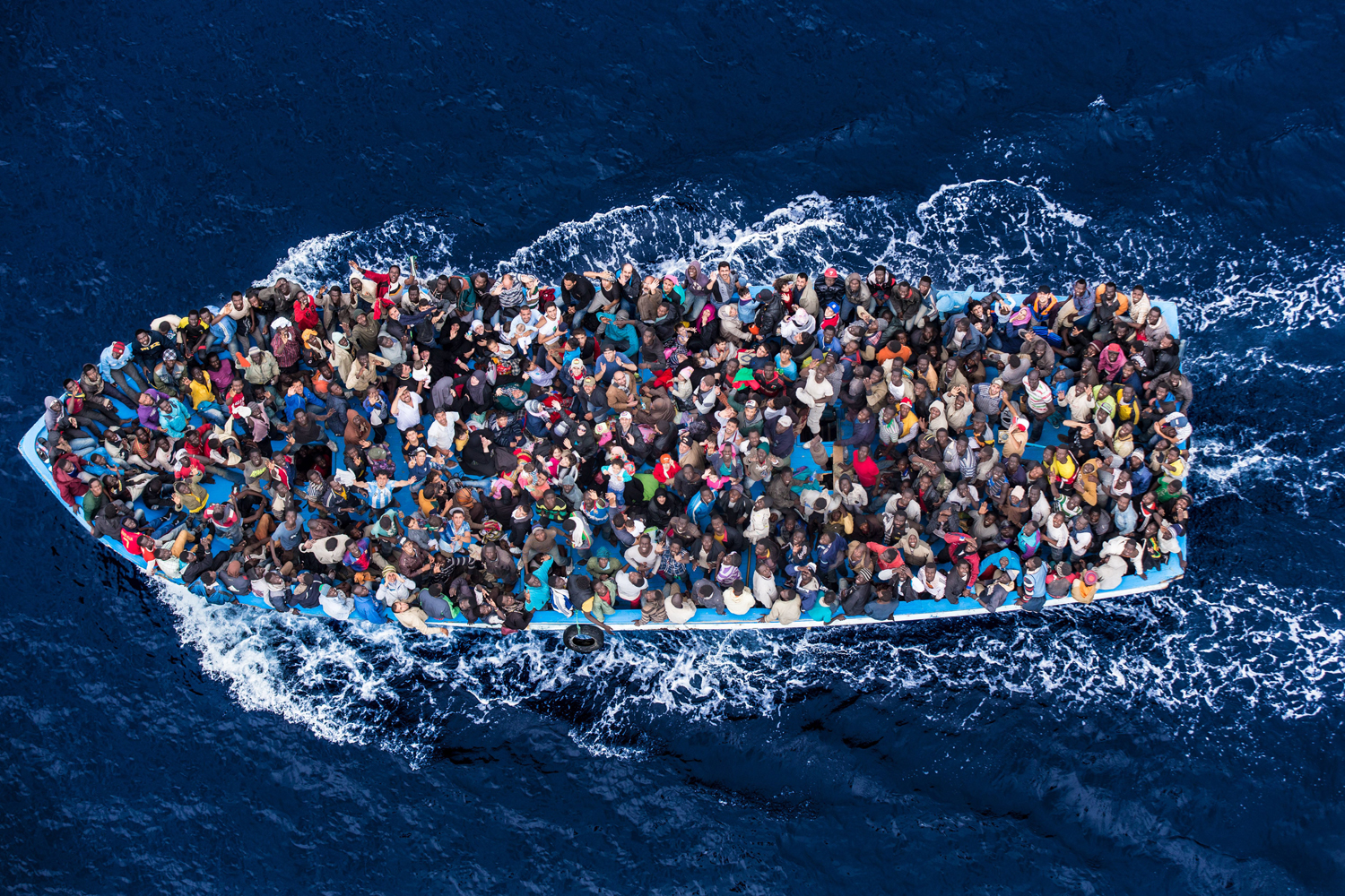 Italian navy rescues asylum seekers traveling by boat off the coast of Africa on the Mediterranean, June 7, 2014.
