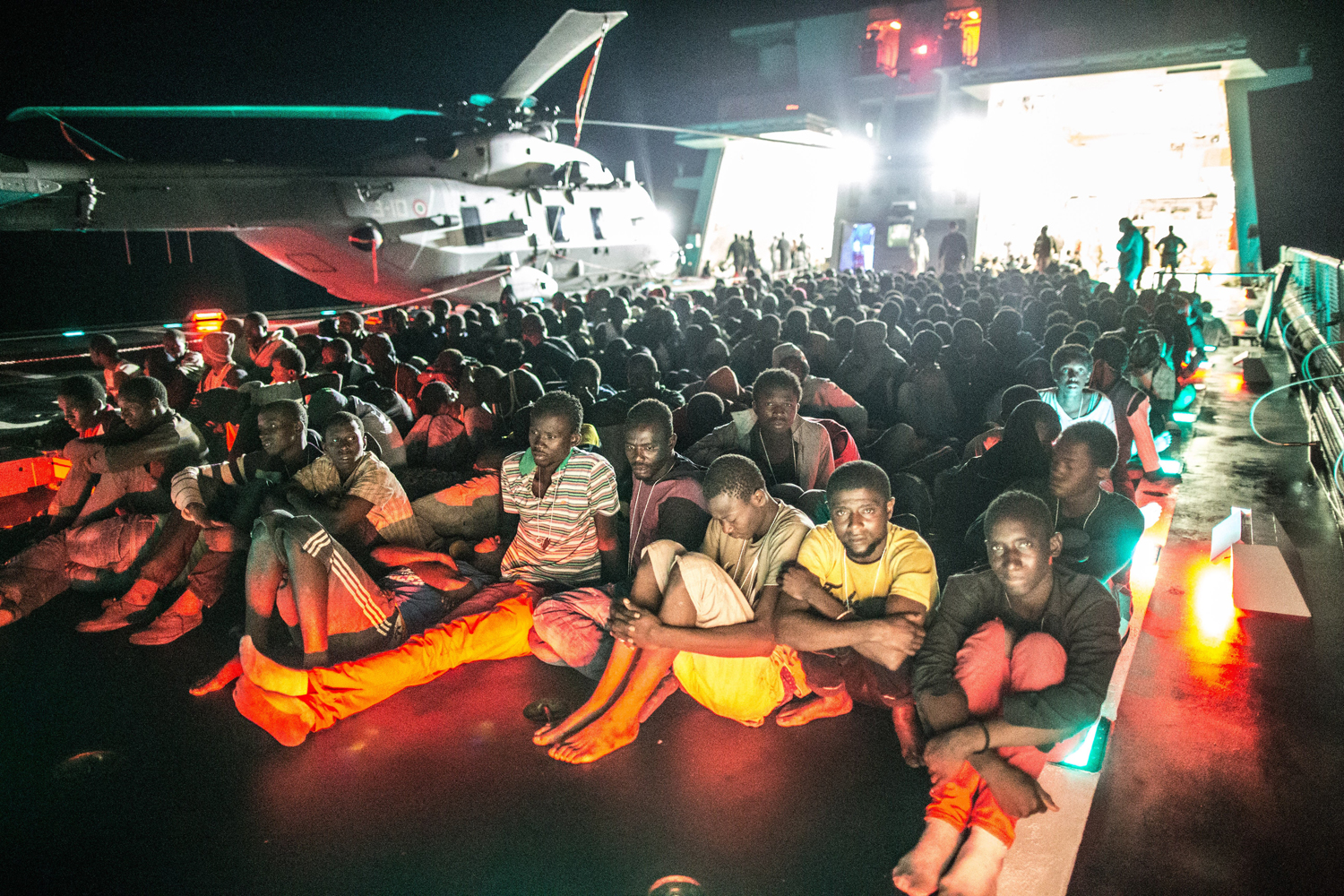 African asylum seekers rescued off boats and taken aboard an Italian navy ship, June 8, 2014.