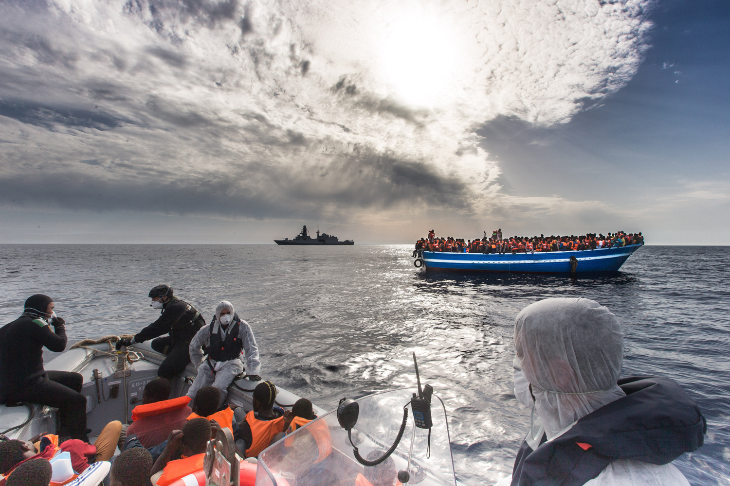 Refugees rescued off a boat and carried onto an Italian navy ship, June 7, 2014.