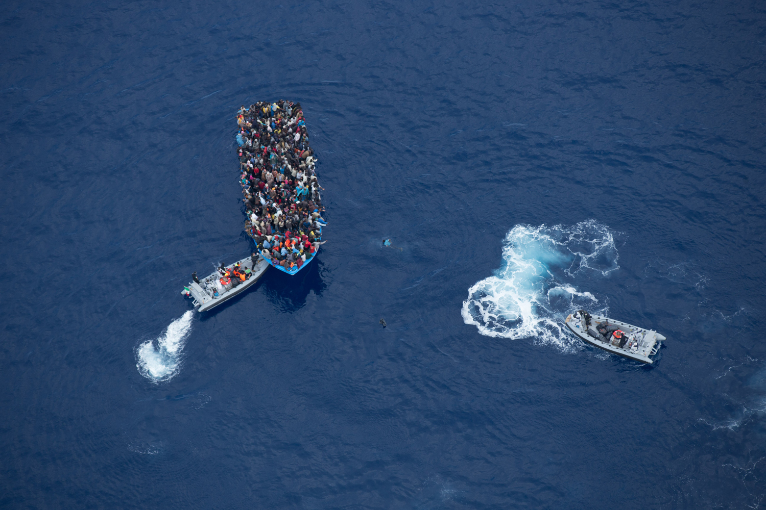 Italian navy rescues asylum seekers traveling by boat off the coast of Africa, June 7, 2014.