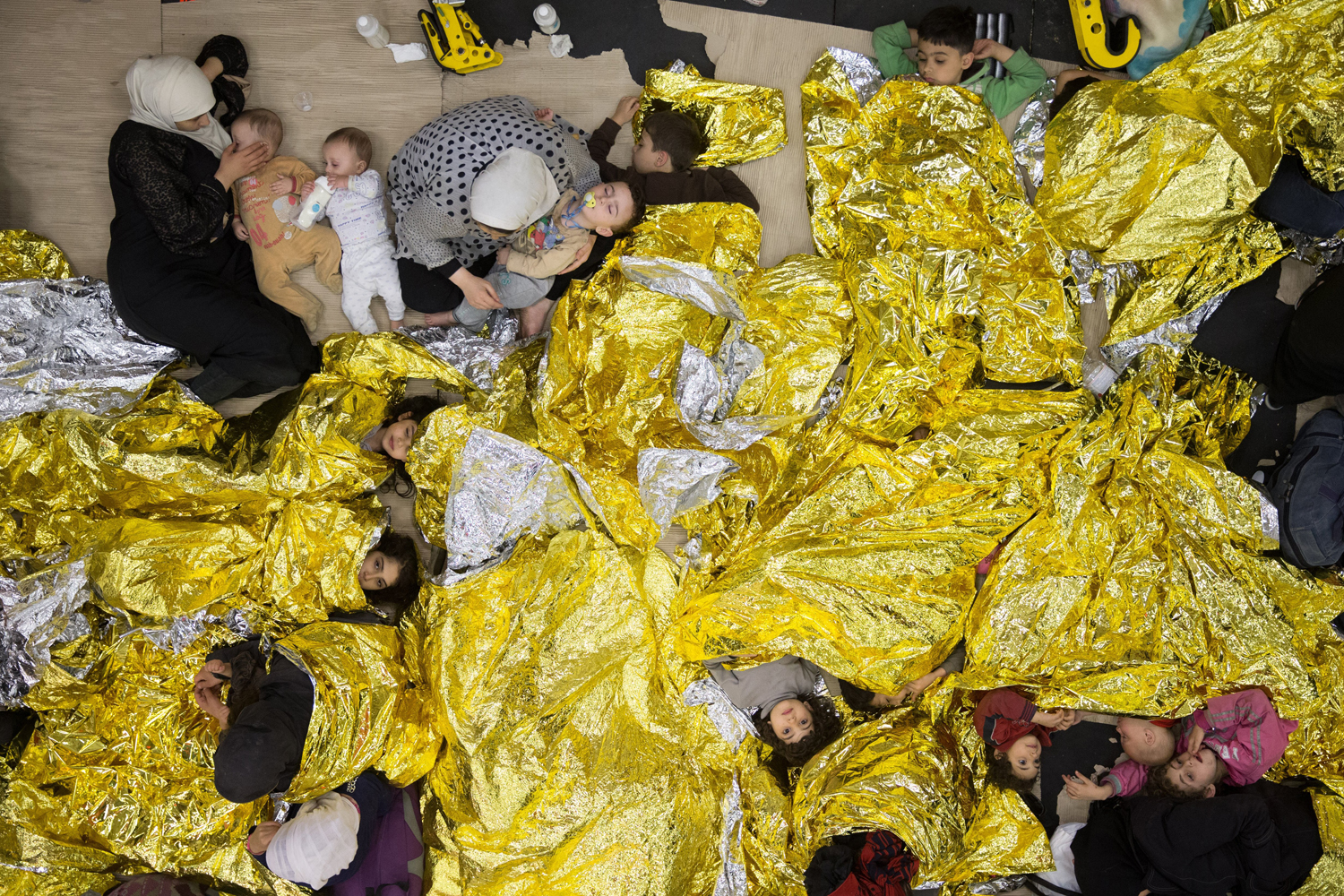 Syrian refugees sleeping on an Italian navy ship after being rescued from a fishing vessel carrying 443 Syrian asylum seekers, June 5, 2014.