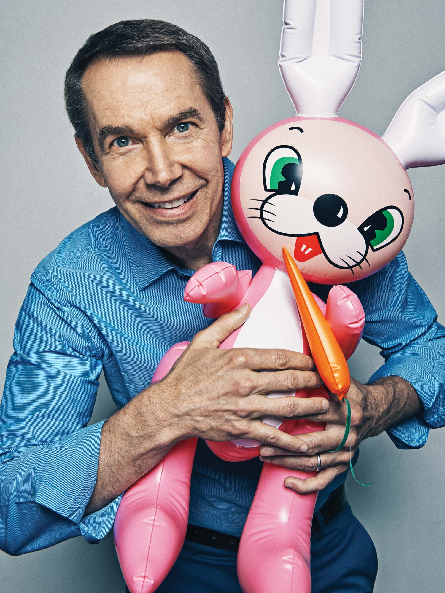 PUFF PIECE                       Koons with an inflatable rabbit of the kind he used in some of his earliest exhibited readymades