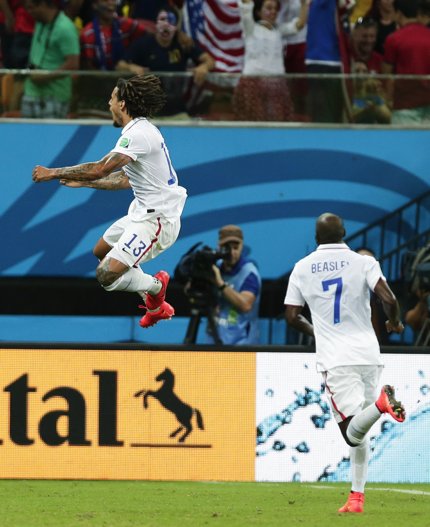 Jermaine Jones, left, celebrates with DaMarcus Beasley, right, after Jones scores USA's first goal in World Cup match against Portugal in Manaus, Brazil, on June 22.