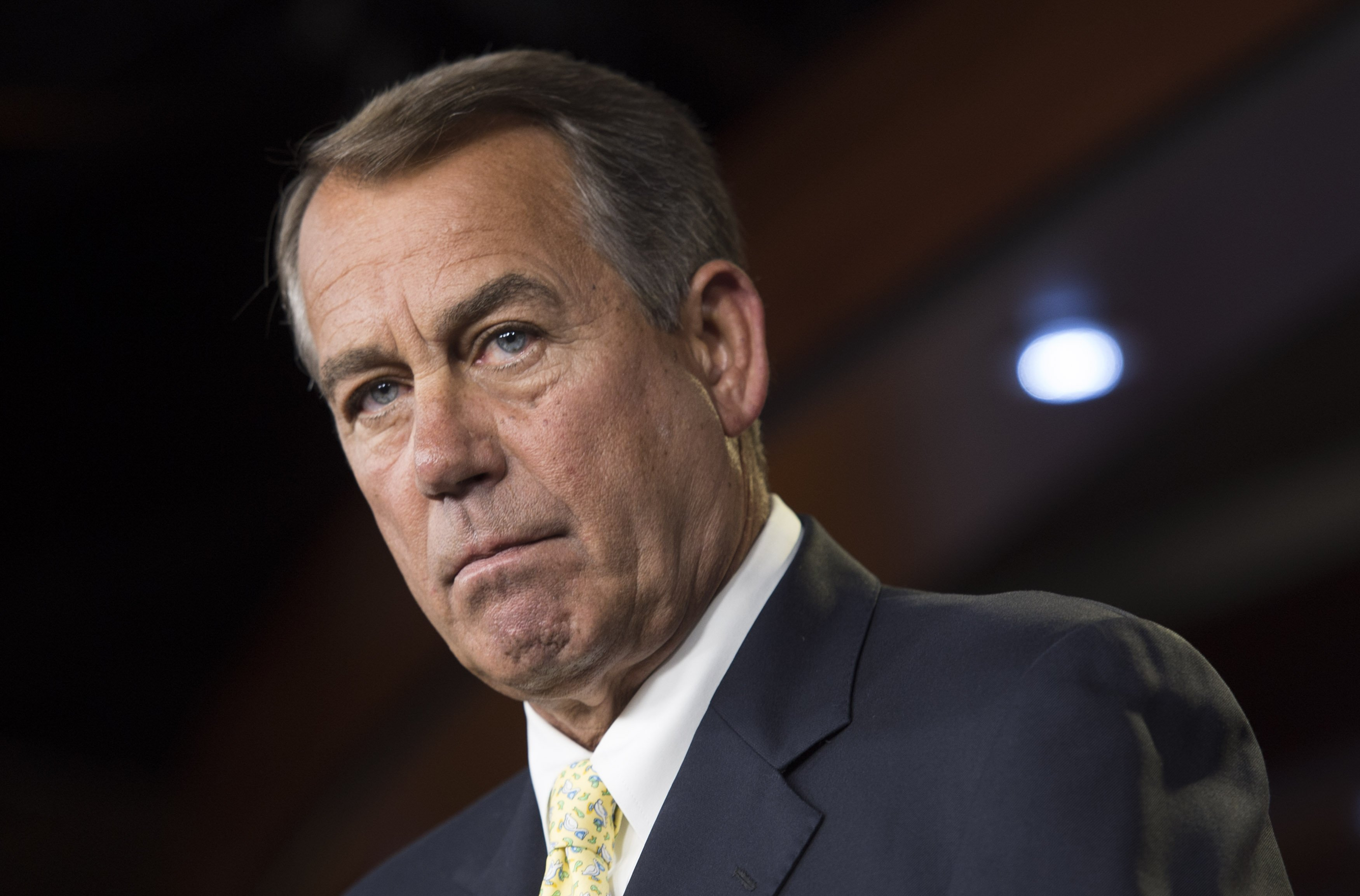 Speaker of the House John Boehner speaks during a press conference on Capitol Hill, in Washington, on June 19, 2014