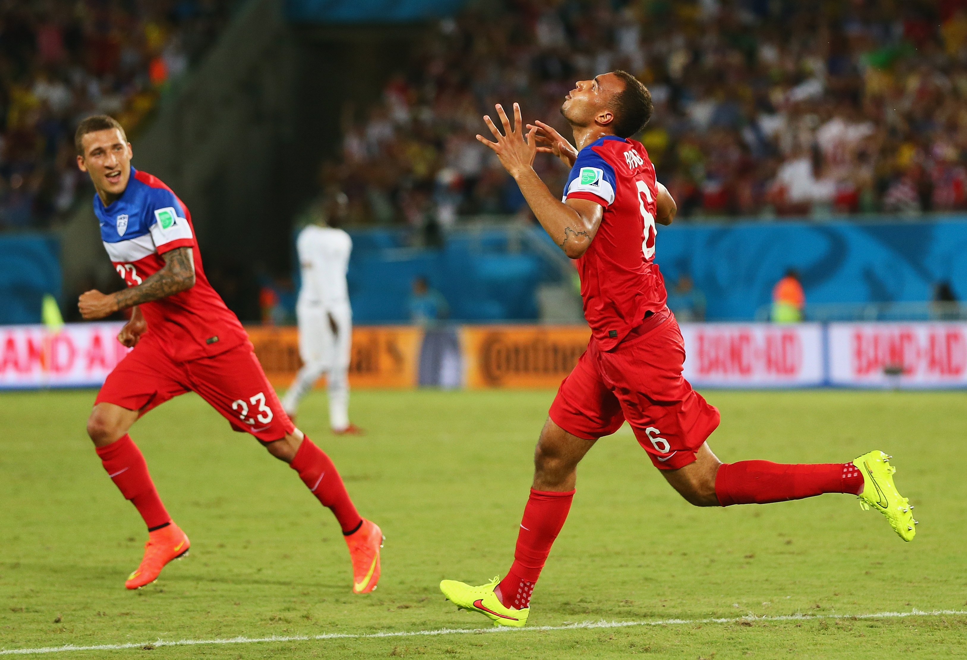 From right: John Brooks of the United States celebrates scoring his team's second goal with Fabian Johnson during the 2014 FIFA World Cup Brazil Group G match between Ghana and the United States at Estadio das Dunas on June 16, 2014 in Natal, Brazil.