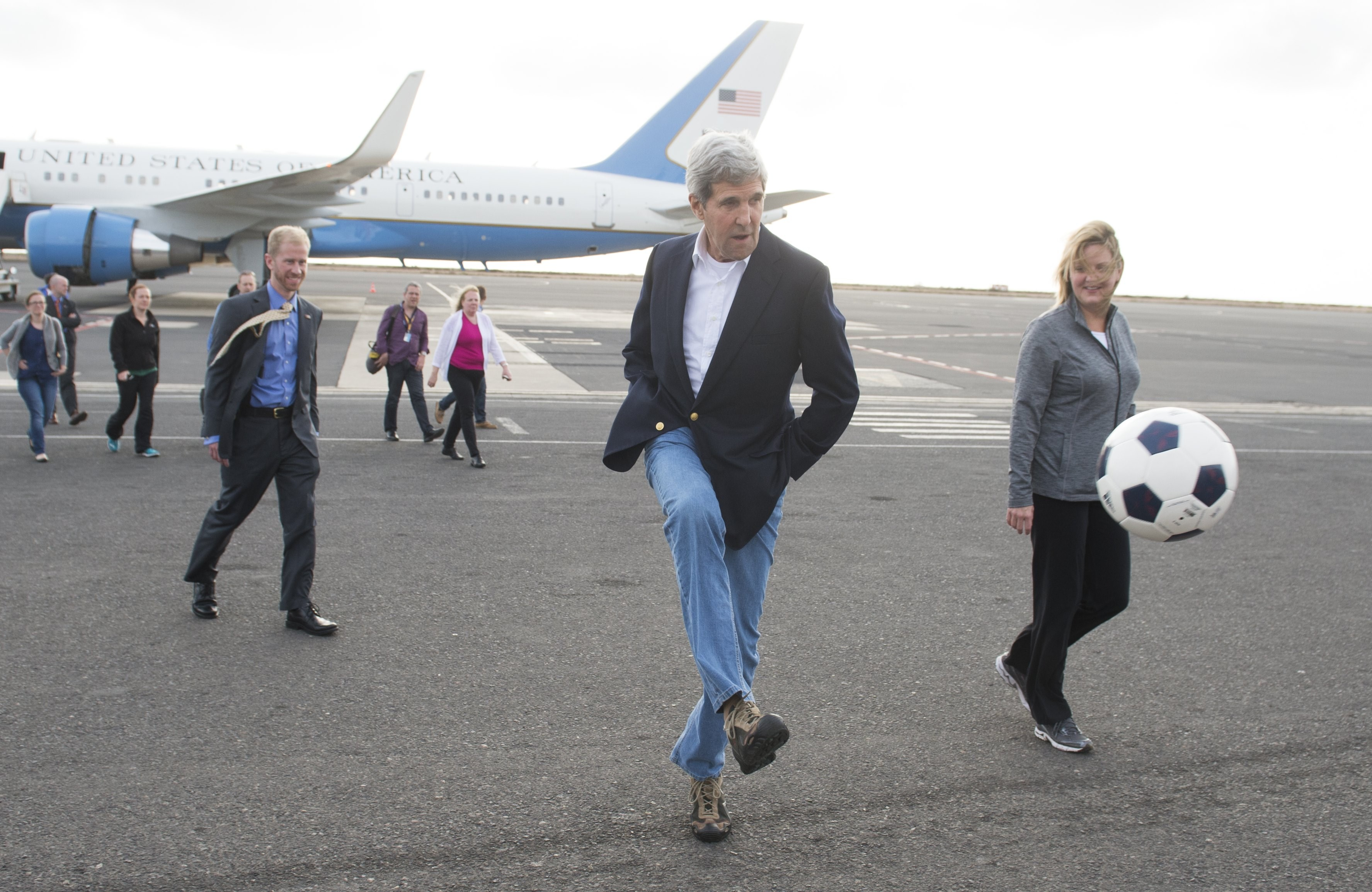 US Secretary of State John Kerry kicks around a soccer ball during an airplane refueling stop at Sal Island, Cape Verde, on May 5, 2014.