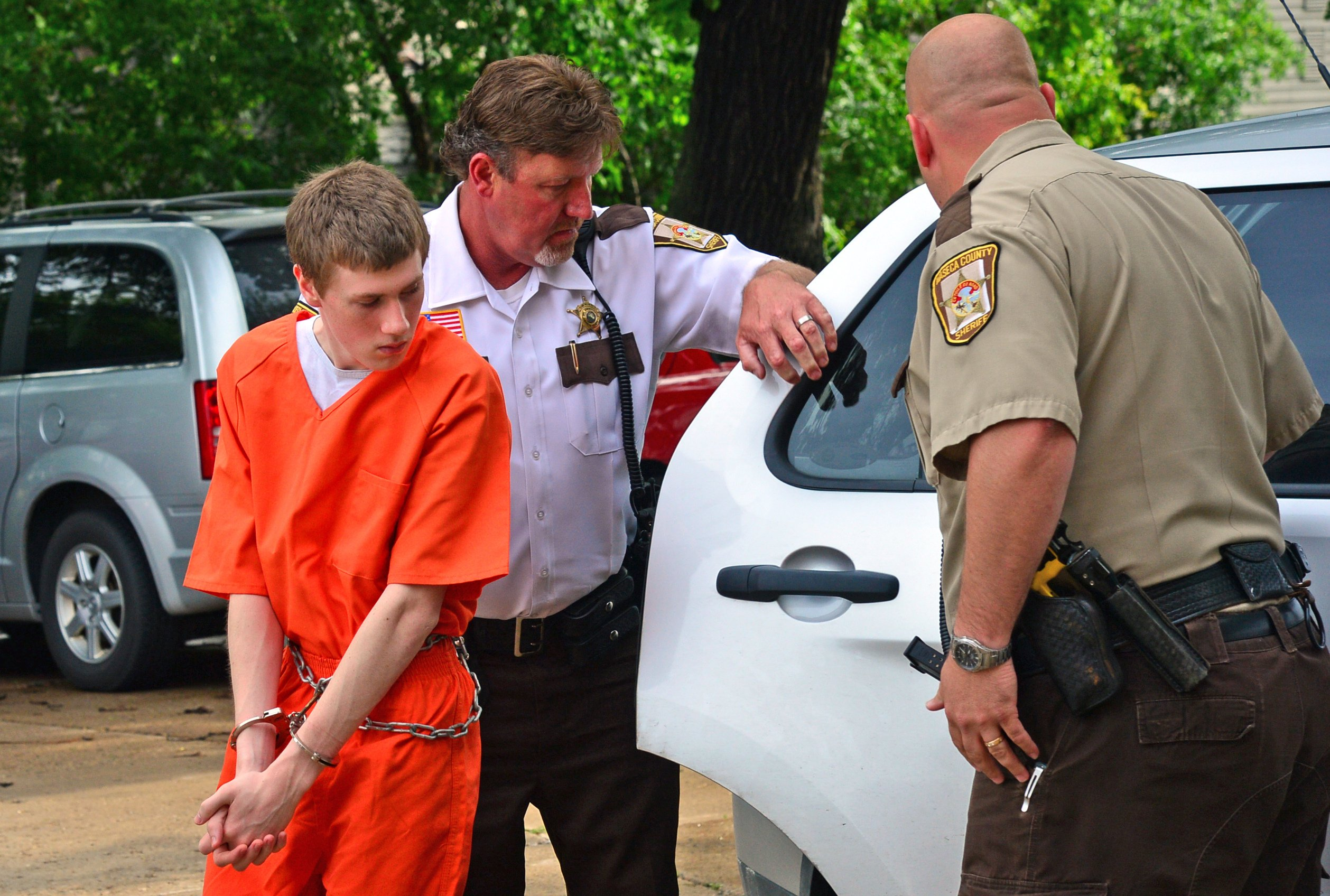 John LaDue, accused of planning an attack on his school was scheduled to make an appearance in court, Waseca County Sheriff's  deputies walked him into the Waseca County Court for a  morning hearing in Waseca, Minn., June 18, 2014.