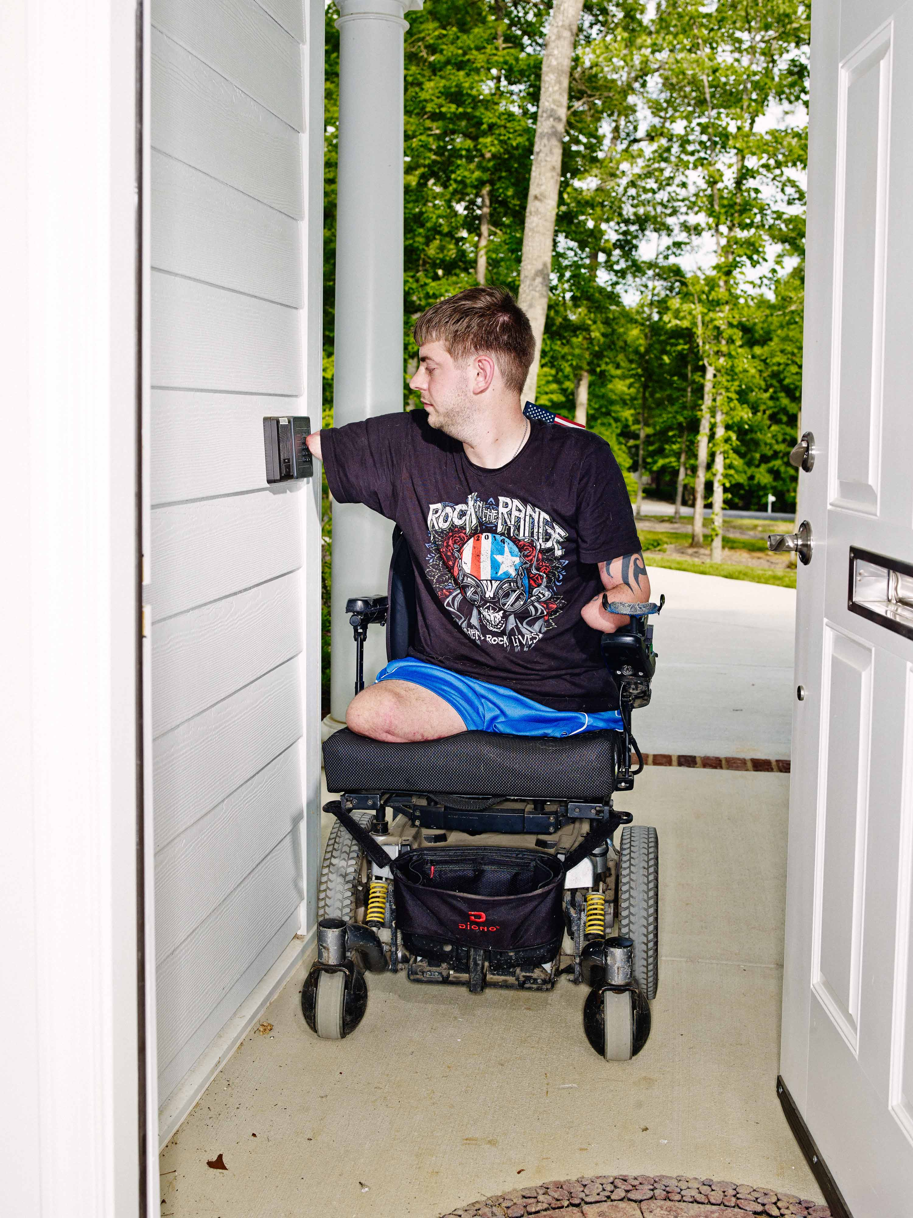 Peck inputs a code to automatically open the exterior doors of his house.  I don't have to push against them with my wheelchair anymore,  he says.