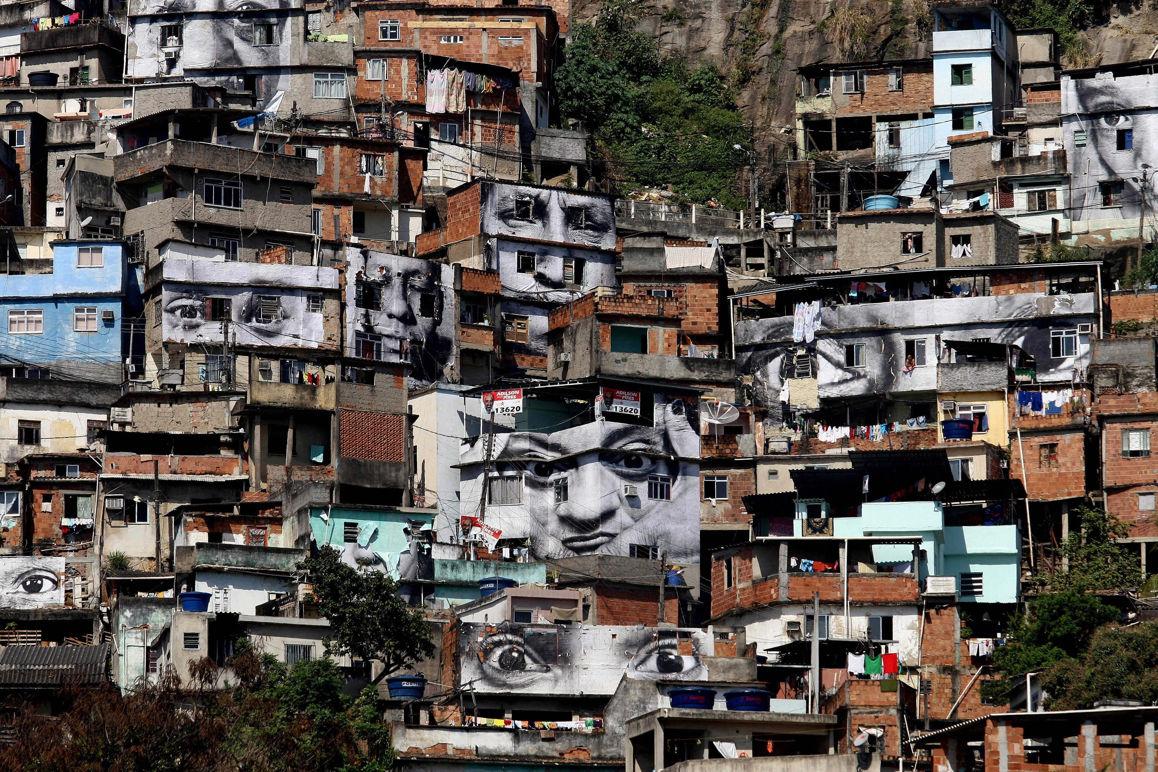 French street artist JR's <i>Women Are Heroes</i> dominates the Morro da Providencia favela, one of Brazil's most dangerous, in Rio de Janeiro, August 20, 2008.