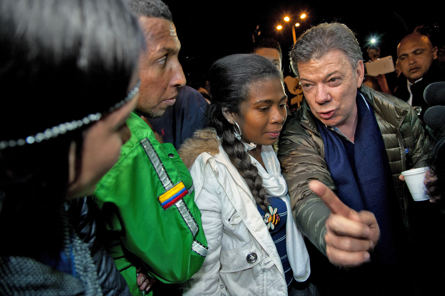 Trying to hold on, Colombia's President Juan Manuel Santos talks to voters at a campaign rally in the capital, Bogotá