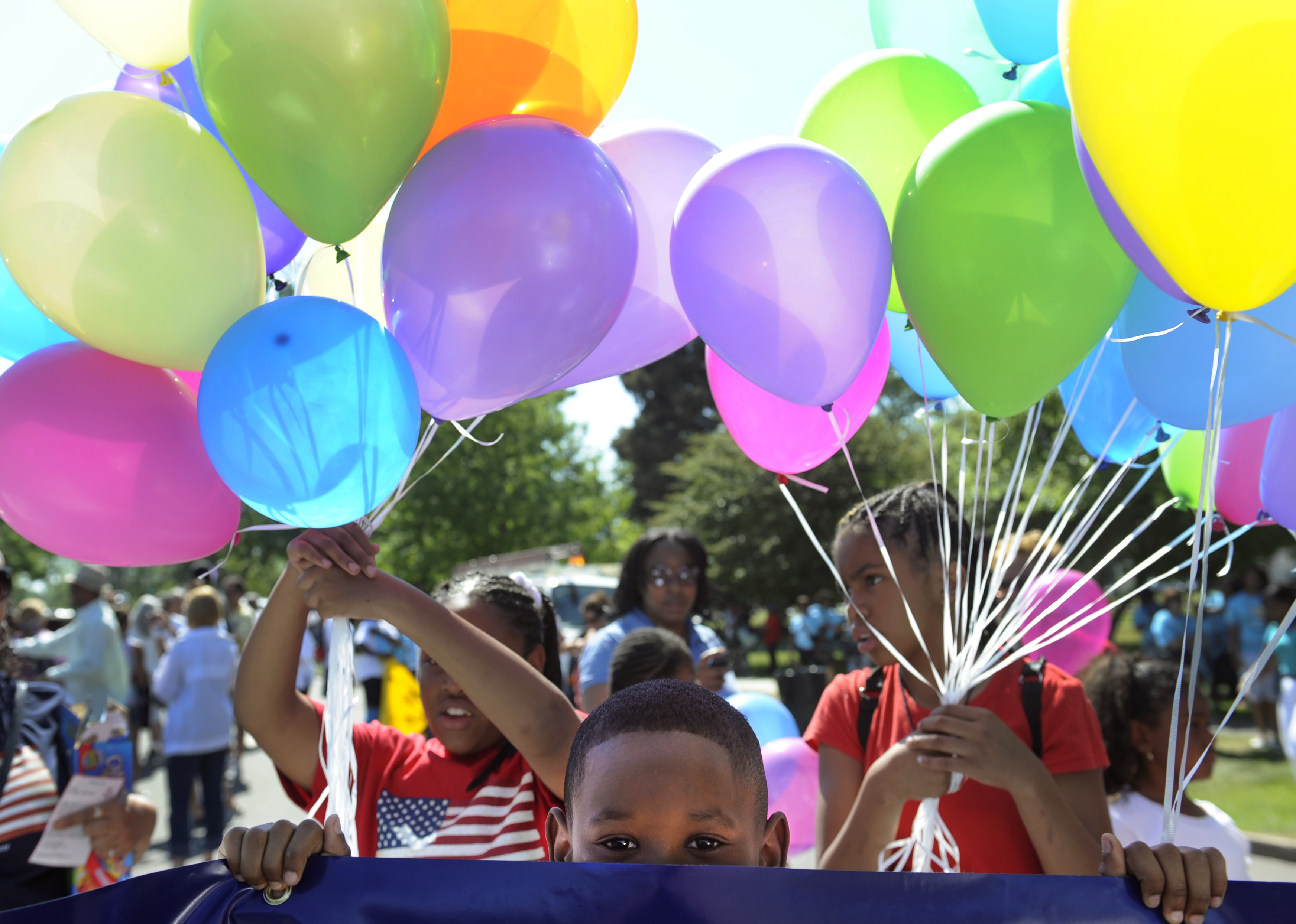 Brian Harris, 8, waits for the Denver Juneteenth parade to begin with his mom and other employees from US Bank in Denver on June 18, 2011.