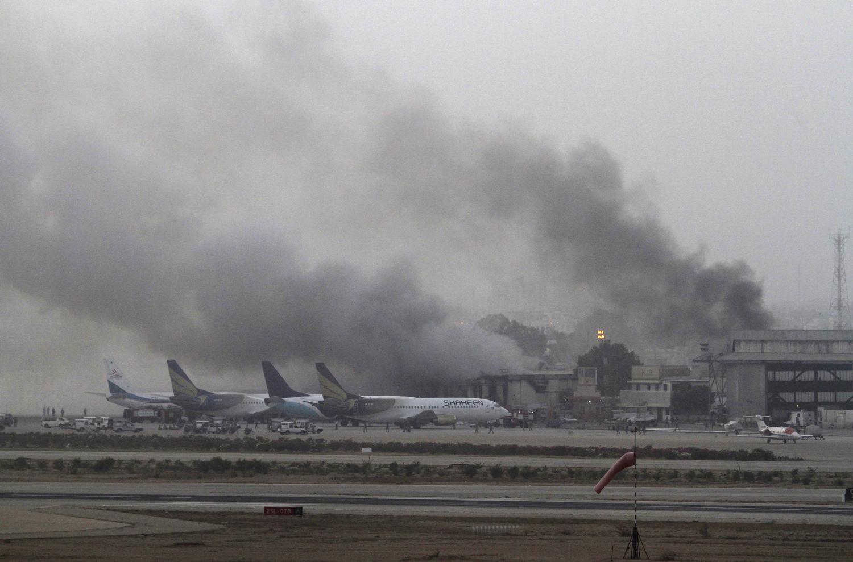Smoke billows from Jinnah International Airport in Karachi on June 9, 2014.