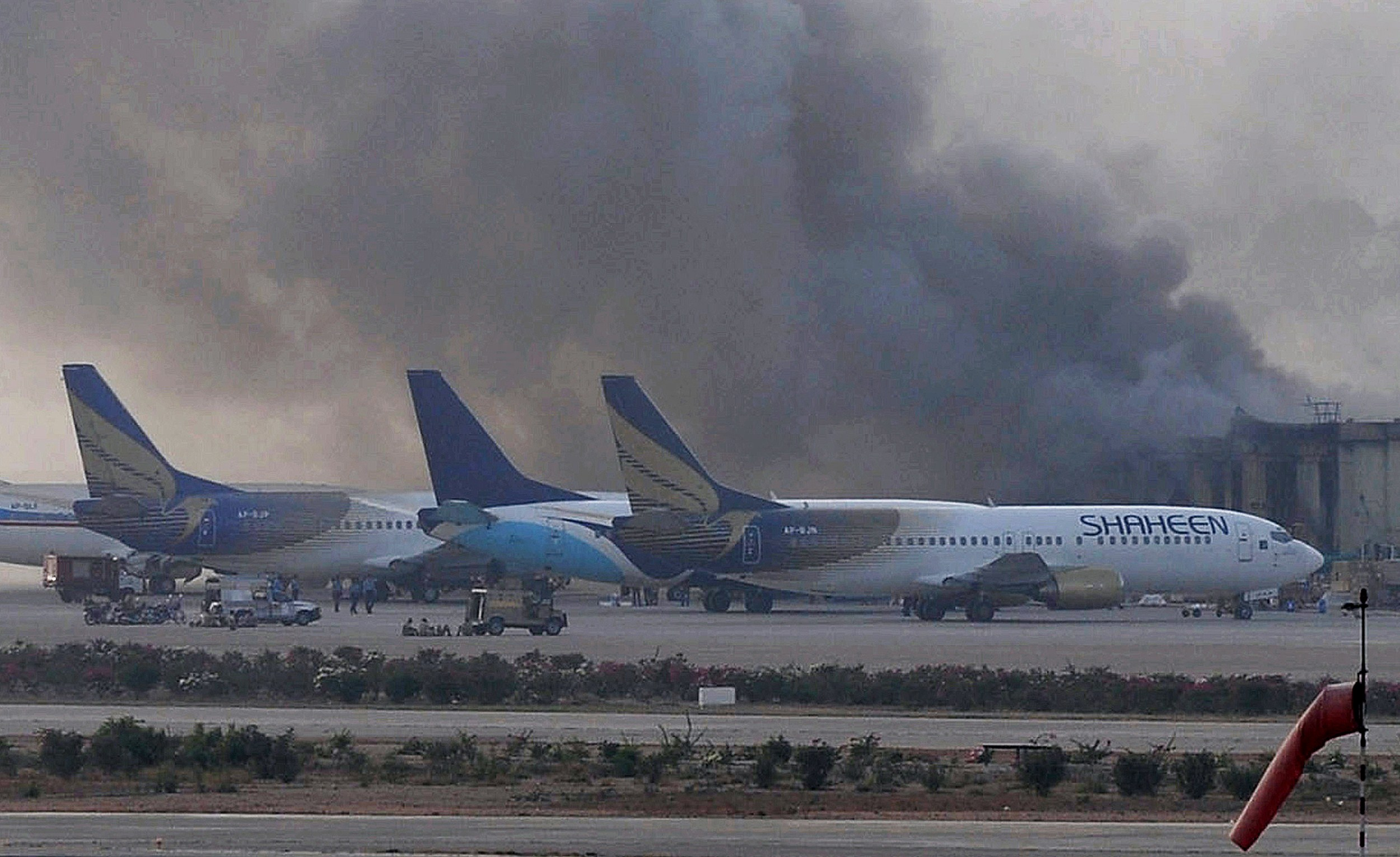 Smoke rises after militants launched an early morning assault at Jinnah International Airport in Karachi, Pakistan on June 9, 2014.